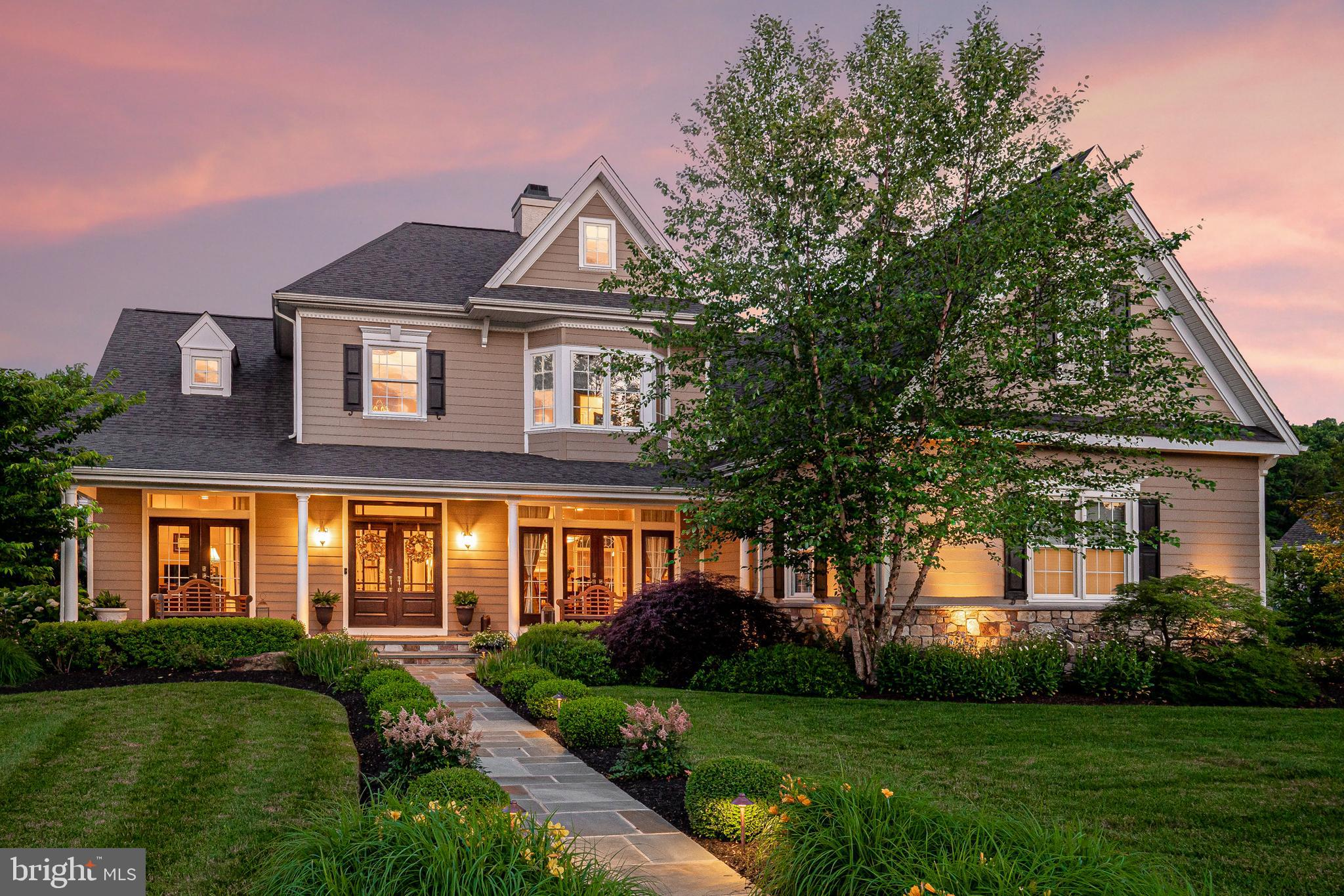 With an outdoor oasis including a pool and covered patio, a basement with custom bar and wine cellar and an open concept floor plan with a strategic flow for entertaining, 304 Spring Meadow Drive is more than just a home, it is a true retreat. No expense was spared in the crafting of this home, with over $475,000 in upgrades completed after the initial build. From a charming front porch, enter through double doors into a two-foyer with detailed millwork. Throughout the first floor are 10' ceilings and site finished hardwood floors. The sizable dining room is anchored by french doors to the porch on one side and a fireplace with a marble surround on the other. A butlers pantry highlighted by a stunning mirrored backsplash leads to the kitchen. A gourmet kitchen with 6-burner cooktop with griddle, a marble backsplash with mosaic and an oversized island open to the breakfast area and great room. Flooded with natural light this space is perfectly spaced and designed. Off the breakfast room is a composite deck with gas piped for grilling and has to the patio. The study (or formal living room if preferred), a powder room and the master suite are situated on the other side of the central hall. This main level master offers a spacious walk-in closet with custom closets and a sumptuous master bathroom with a soaking tub, a marble shower and dual vanities. The laundry room is also conveniently located on the main floor. Upstairs, there is an open loft, a bedroom with ensuite bath and two other bedrooms one which connects to the hall bath. In the lower level, a study or exercise room and a full bath takes up just a portion of the nearly 2000 sq ft of finished space. There is plenty of room for the pool table, gaming space and a media area but the focal point is the custom wet bar with a beverage center, icemaker and wine cellar. French doors lead to the covered porch overlooking the flat back yard and impressive pool with a sundeck, waterfall, water features and spa. Situated 