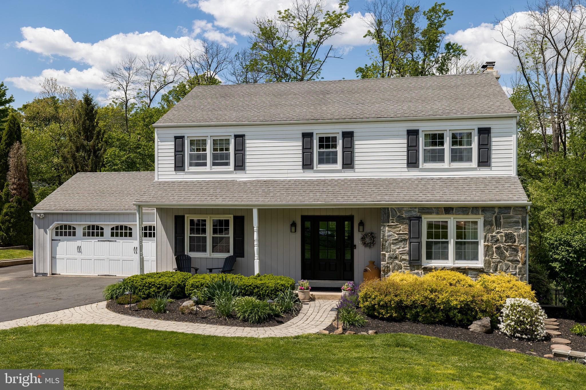 Discover the very best in relaxed living with this stunning Colonial set on a beautiful park-like lot in the award-winning West Chester Area school district.  A brick paver walkway winds through the immaculate gardens to the front porch that invites you to sit awhile before stepping inside to explore this elegant abode.  The layout is bright and welcoming with an open-concept floor plan perfectly crafted for entertaining.  There is a living room and dining room, plus a beautifully remodeled kitchen with stainless steel appliances, a breakfast area and hardwood floors.  The kitchen takes in views over the family room complete with a stone fireplace and slider doors that open out to a wonderful screened porch that is awaiting you and your morning coffee. There are five large bedrooms and 3 full bathrooms and 2 powder rooms including your second-level owner's suite with a walk-in closet and a luxurious master bath. There are three additional bedrooms also housed on the second level while the finished lower level features extra living space with an in-law suite and a walkout to the amazing backyard.  Here, you are treated to an entertainer's oasis with covered lounge areas and a sparkling built-in pool plus sweeping views over the lush lawn and out to the treeline.  Outdoor lighting brings this haven to life at night.  Extra features include a two-car garage, a whole-house generator, ceiling fans throughout and a huge storage shed. This is a truly move-in ready home just waiting for you to unpack and enjoy.