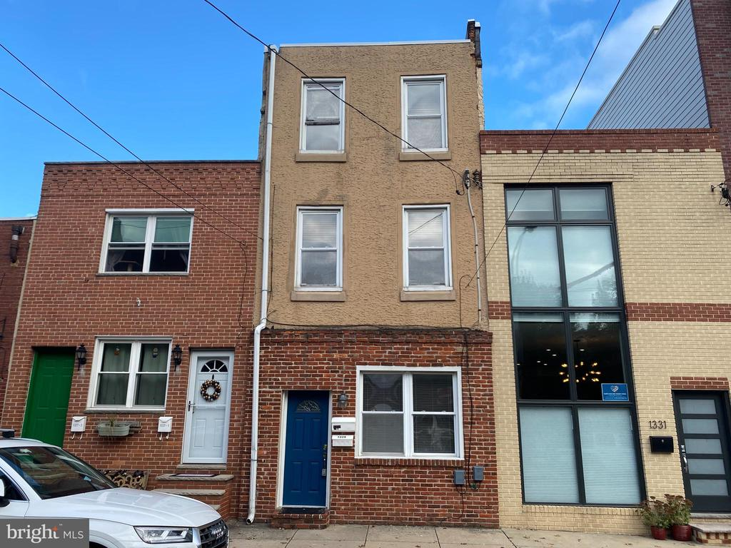 LOTS of value in this Income Producing Duplex on a large street to street lot with 2 CAR PARKING!  Live in one unit and rent the other, or rent both...Either way it's a great investment!  First floor is a large one bedroom with private basement access and is tenant occupied (rented for $1,225).  Second floor is a large bi-level 2 bedroom unit, currently listed for $1,650/mo.  Booming neighborhood, primarily residential with several great neighborhood favorite establishments a few blocks away, such as Herman's Coffee, Cake and Joe, The Dutch, Pennsport Beer Boutique, Federal Donuts, and more!