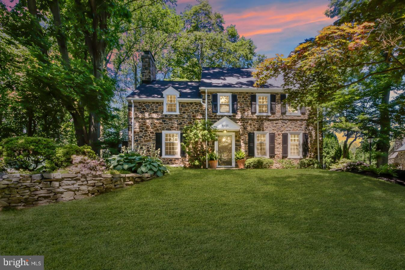 This is the one on Whittier Rd.! Stately, stone circa 1937 – 4 Bed/3.5 bath Colonial in Brandywine Hills is majestically perched on gently sloping lot with waterfall of blooms and bushes, pockets of perennial plantings and stone walls enhancing landscaped beds. Detached stone, 2-car garage is tucked behind home, preserving graceful front curb appeal. Amid one of largest lots for the city, home is nestled on coveted street with myriad of city conveniences. Home is 1 block from Delaware Greenway/Rockwood Park, 10 mins. to downtown Wilm. restaurants/entertainment/Amtrak train station and 25 mins. to PHL Int'l. Airport. Enjoy upgrades of new paint in many interior rooms/stove (2021), new exterior paint (2020), new roof/gutters (2019), new patio (2018) and 2.5 renovated baths. Also new: plantation shutters, recessed lighting, landscaping w/ invisible fence, newer windows and kitchen. Old world charm blends with modern, must-have amenities! Appreciate earlier decade-defining details like random width peg board floors, deep recessed windows, arched doorways, ornate crown molding, lovely build-ins, exposed radiators, glass knobs and more. Natural wood French doors lead into LR where built-in bookcase borders wood burning FP, wainscoting/crown molding edge perimeter and bay window spans back wall. French door leads to sunken side 3 season sunroom with exit. Exposed stone wall and floor mingle with series of windows and natural wood paneling to create room that blooms! The room was cleverly converted into 1st-floor, off hub-of-home office with privacy and personality. From FR, access to hall and PR with angled ceramic tile floor and angled ceramic tile top vanity and copper sink, closet and entrance to LL. Carpeted LL FR boasts charming brick FP flanked by build-in bookcases with generous screen on wall. Approachable space where movie nights are quite the delight! Note unfinished area of W & D/dual utility sink with guarantee of storage and easy, walk out. Off foyer and oppos