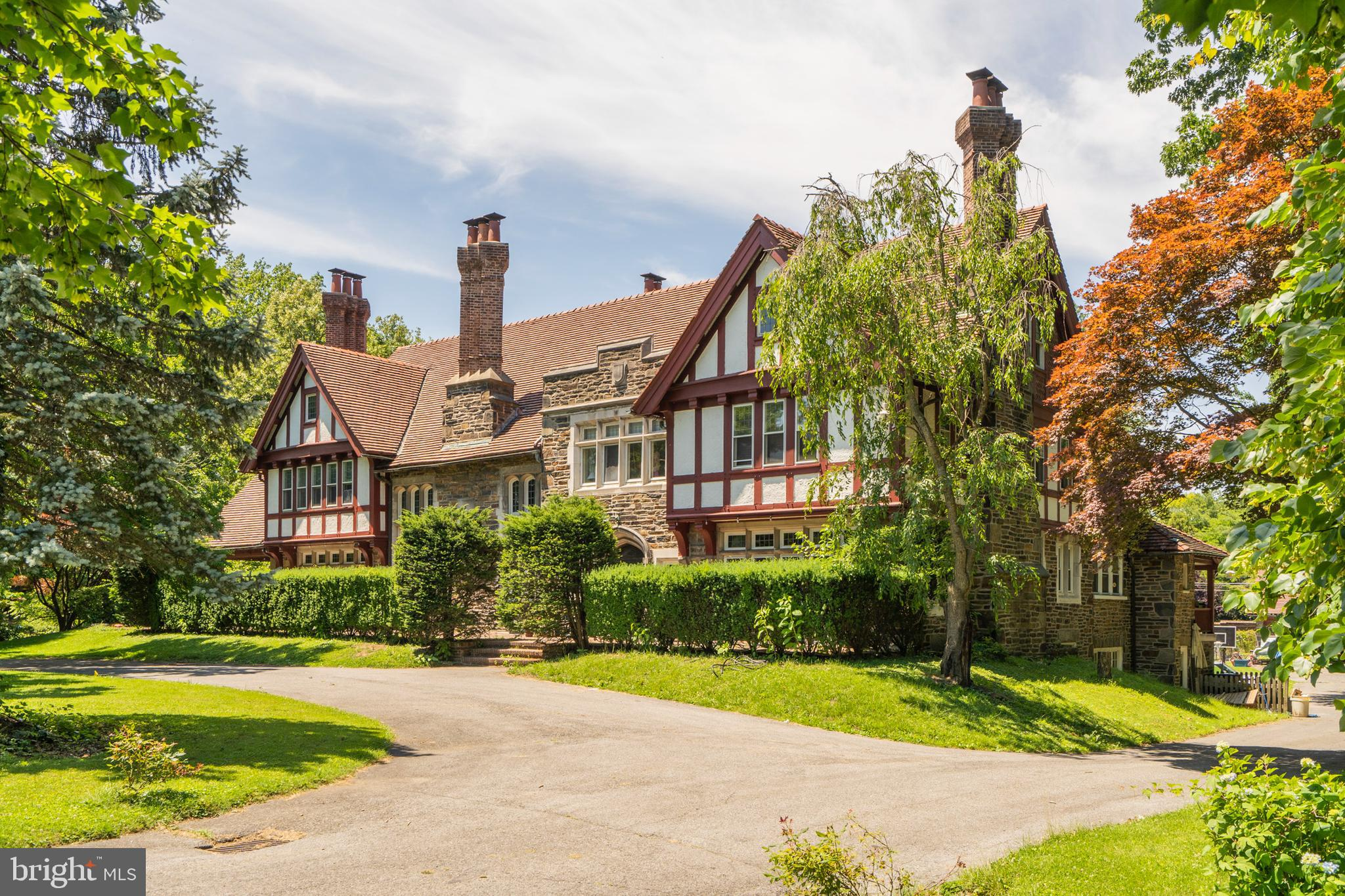 Incredible opportunity to own a piece of Main Line History. This grand Tudor estate built by Albert Barnes offers magnificent architectural detail, gorgeous stone masonry and unsurpassed moulding, woodwork and carvings. This exceptional property offers over 9000' sq. ft. of living space, 8 fireplaces, 13 chimneys, 8+bedrooms, leaded glass windows, a separate carriage home with living quarters and a gorgeous 1.7 acre deep, private lot. The first floor of this home offers enormous rooms including a breathtaking grand hall entry with original red oak flooring, paneling and ceiling beams.  Large formal Living Room and Library feature stunning fireplaces and woodwork. Extensive eat-in kitchen with 2 gas ranges, wood cabinetry and quartz countertops. Completing the first floor is a large office with wonderful views of the sprawling backyard. The 2nd and 3rd floors of this home do not disappoint with 12 rooms several with en suite bathrooms and uses as bedrooms, studios, exercise rooms and offices. The enchanting grounds are private, quiet and picturesque filled with mature plantings and lovely gardens. Truly a remarkable property carefully designed with world class materials and workmanship.
