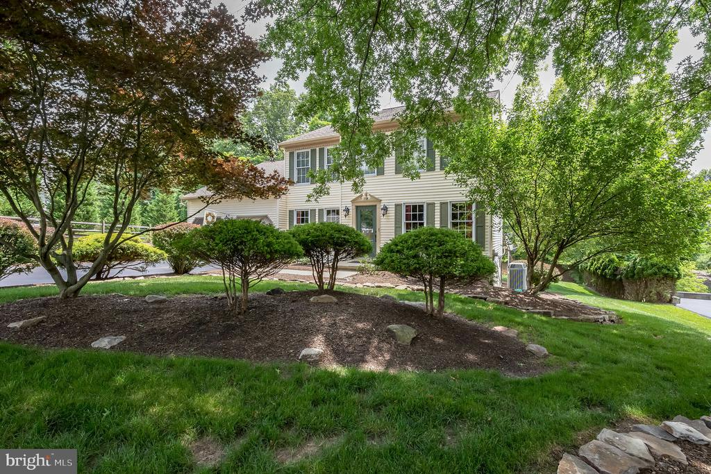 Looking for an updated, meticulously maintained, move-in ready 4BR home in highly sought-after Spring-Ford School District? You've found it! This home has it all, both inside and out. Gleaming maple hardwood floors run throughout the first floor, starting at the open foyer. The open living room and dining room at the front of the home are made for gathering family and friends. The large family room with fireplace opens to an eat-in kitchen with upgraded cabinets, granite countertops, a large peninsula where everyone is sure to gather, stainless steel appliances (including a double oven), and French doors. Completing the first floor laundry room and half bath. Upstairs you'll find a large owner's suite with the same hardwood flooring, a separate sitting area, walk-in closet, and a full en suite bath that's sure to wow - with a huge tiled walk-in shower with frameless doors, tile floor, dual custom vanities with quartz countertops and upgraded faucets. The 2nd floor offers 3 additional bedrooms (including an oversized bedroom above the garage) and a hall bath with custom vanity, quartz countertop, and tiled shower/tub. Need even more living space? The fully finished walkout basement provides plenty of additional, light-filled finished space to use however it suits you, including an additional bonus room! Outside, you'll find a brand-new triple-level deck with no-maintenance vinyl railings and integrated lighting – giving you lots of room to entertain or just kick back and relax. The two-car garage (featuring a bump-out storage area with cabinets and countertop) and separate shed provide all the storage space you could ever need. It's all situated on a large lot with mature trees for privacy and beautiful, well-maintained landscaping. Tucked away on a quiet street, but still close to 422, Providence Town Center, and Philadelphia Premium Outlets, this house is just waiting for you to move in!