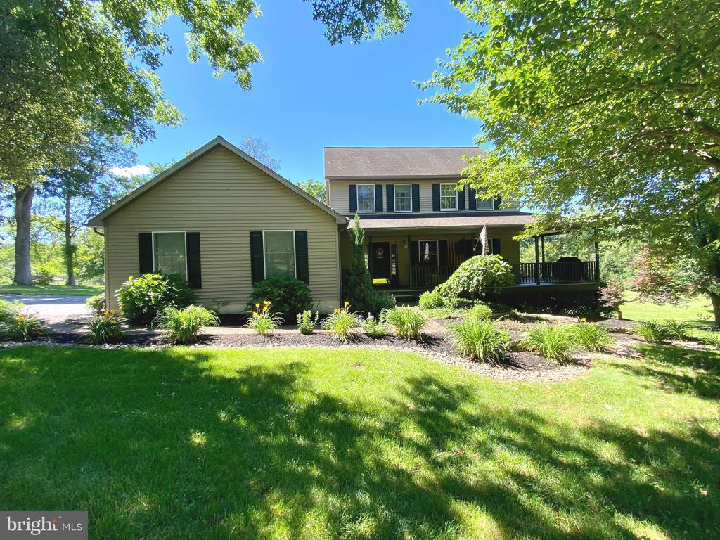 Welcome to 5 Yellow House Drive!  This 4 bedroom, 2.5 bath colonial doesn't disappoint.  Nowadays many homes are crammed together in developments, but not this one.  This home is located at the end of a dead-end street so you will hardly see or hear any traffic.  The property is bordered on two sides by Arrowhead Golf Course, which provides nice views and extra privacy.  Since all of the neighboring homes are located on large lots, you will get all the benefits of living in a neighborhood but you won't feel cramped.  The yard has beautiful landscaping, providing shade, character, and even more seclusion.  Sit on the wrap around porch or newly coated back deck to enjoy the pristine exterior views!  Enter through the front door to a foyer with hardwood floors.  Turn right to enter the main living room, or continue down the hallway past a half-bath to the huge eat-in kitchen complete with built-in appliances and breakfast bar.  Admire the view of the golf course through the sliding glass doors that lead to the back deck!  Through the right side of the kitchen is the formal dining room, and the left opens to a spacious family room with a gas fireplace.  Pass the main-floor laundry room on your way to the 2 car-garage.  Upstairs, you will find four bedrooms, one with it's own ensuite bathroom, and an additional full bath.  The basement has been partially finished; you could use it as-is or easily finish it for additional living space.  Schedule your tour of this beautiful property today!