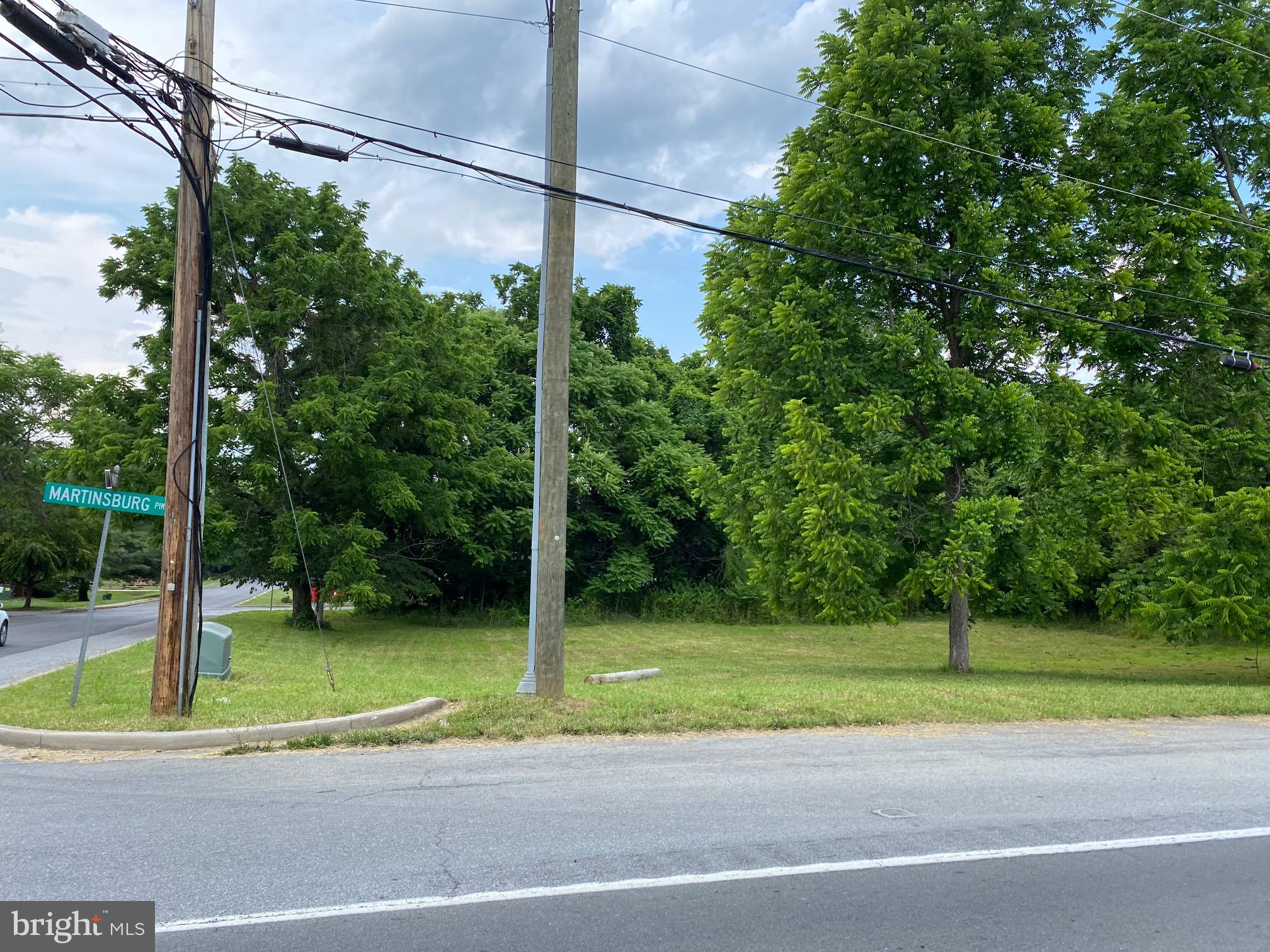 Rare commercial building lot opportunity here!  Corner lot to Route 45/Maddex Drive across from the Shepherdstown Fire Department.  Can not operate any commercial establishment on the premises herein conveyed where gasoline or gasoline products or food or beverages are sold at either wholesale or retail, and that they will no  permit any of their assign or leases to use the premises for the aforenamed purposes.  City water and hook up available.