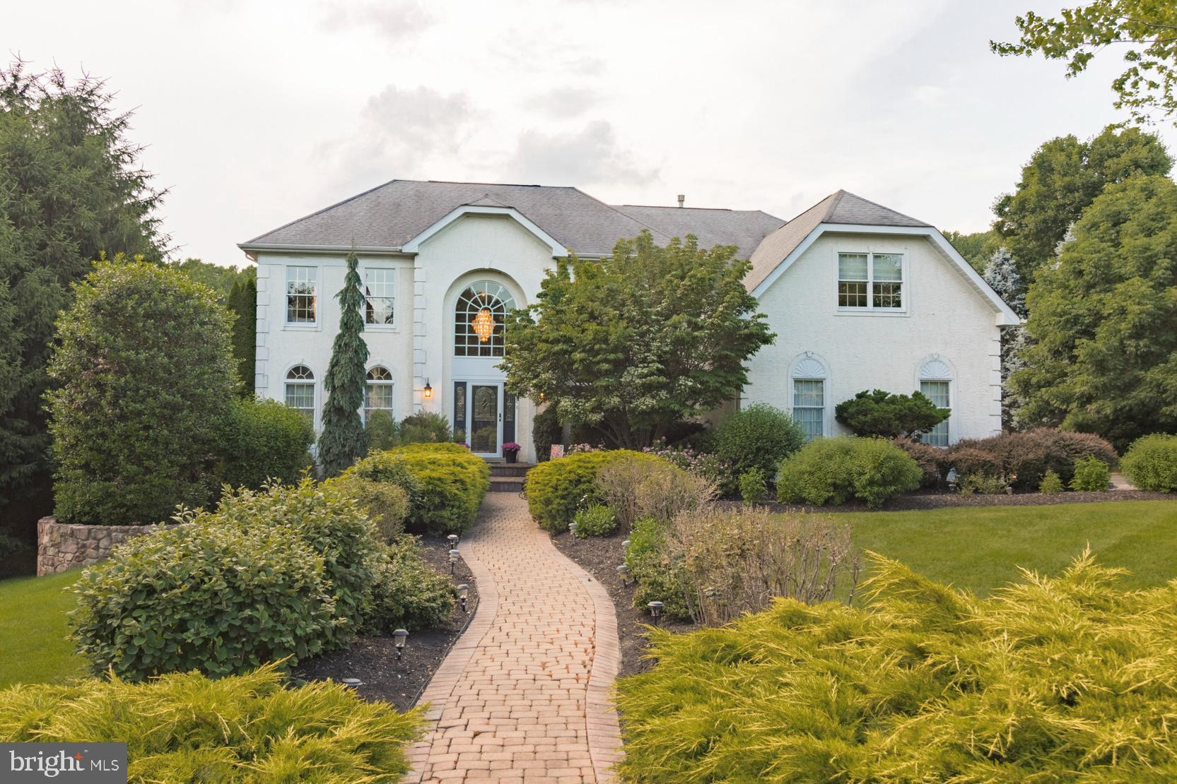 """Brandywine River Estates in West Chester, PA is an enclave of executive homes - thoughtfully planned and spaced. You enter the community through a long, beautifully landscaped, drive that makes you feel as though you are entering a private estate. Here this lovely 4 BR 3.1 bath, approximately 6,100 sq. ft., meticulously maintained home can be found! A manicured walkway leads to the dramatic 2-story foyer with a turned staircase and open views of a warm and inviting floor plan. The foyer is flanked by a Formal Dining Room with custom moldings and a Formal Living Room. The open plan continues to the rear of the home where a cozy 2-story Family Room with views of the private rear yard, brick fireplace and an expansive gourmet Kitchen can be found. The Kitchen features 42"""" cherry cabinets with crown molding and under-mount lighting, large center island, double wall ovens, Subzero refrigerator, Bosch dishwasher, granite counters and tons of counter space. There is also a large Breakfast area and a solarium with access to the rear deck and a level yard that backs up to beautiful open space. The main floor also features a laundry room with access to the 3-car garage as well as a professional office. The second level is highlighted by the Master Suite, which allows the owner to retreat in luxury to their own private space which contains a Sitting Room, 2 walk-in closets, and a spa-like Master Bath with Jacuzzi tub, tile shower, and dual vanities. The open hallway leads to 2 generous-sized guest bedrooms that share a Jack-and-Jill Bath. The 4th Bedroom contains an ensuite Full Bath. The fully finished lower level provides additional entertaining space adding over 1800 square feet of space with walk out access to the rear patio and hot tub. Established trees and landscaping accentuate this level lot which is backed by open space! Amazing location, minutes to downtown West Chester, hiking trails, grocery stores, orchards and easy access to all major routes! Be sure to check ou"""