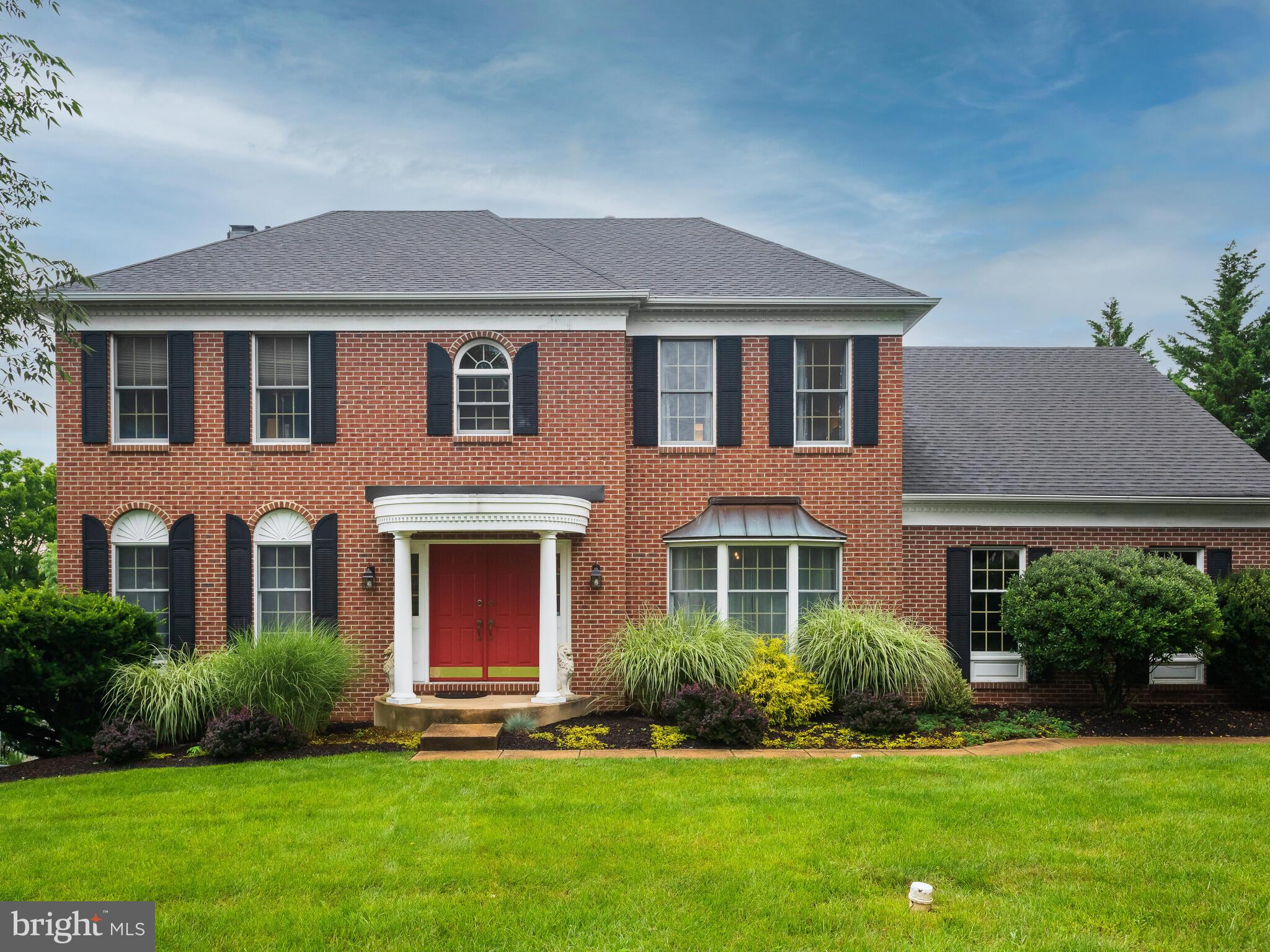 Welcome to 114 Sussex Road. This stately 4 bedroom, 2.5 bath federal style home is nestled in the heart of West Goshen Township in the highly sought after community of Brandywine Knoll. This sprawling space welcomes you by means of the grand 2-story foyer. You are immediately captivated by the light and airy feel to this open concept design that is bathed in natural light. Flanked by both the spacious formal dining room and also the formal living room, this space transitions seamlessly to the heart of the home located toward the rear of the home, the custom kitchen. Complete with rich medium hued cabinetry that pairs perfectly in two-toned cabinetry trend with the island, this area holds ample counter space that is dressed in granite, and the island holds a charming butcher block top accent. This area of the home holds an eat-in option as well and through sliding glass door accent blends indoor and outdoor living seamlessly. Step onto the spacious deck that overlooks the private level lot. It is easy to envision your endless entertaining options from this area. Back inside the home you will also find the kitchen connects fluidly to the family room, complete with brick fireplace focal feature. Unwind after a long day in this comfortable space. The second story of the home houses the four bedrooms of the home. The primary bedroom is truly an owner's oasis, with double door access, walk-in closet, a spacious sitting area, and private en-suite. The private en-suite boasts double vanity sinks, a soaking tub, and private shower feature. The remaining three bedrooms on this floor are sizable, sharing the use of a full hall bath. With ease of access to many major routes and public transportation, 114 Sussex is also just a short drive to all of the convenience that West Chester Boro has to offer. From entertainment, to restaurants and shopping, Boro living is at your fingertips. Make 114 Sussex your next chapter of homeownership.