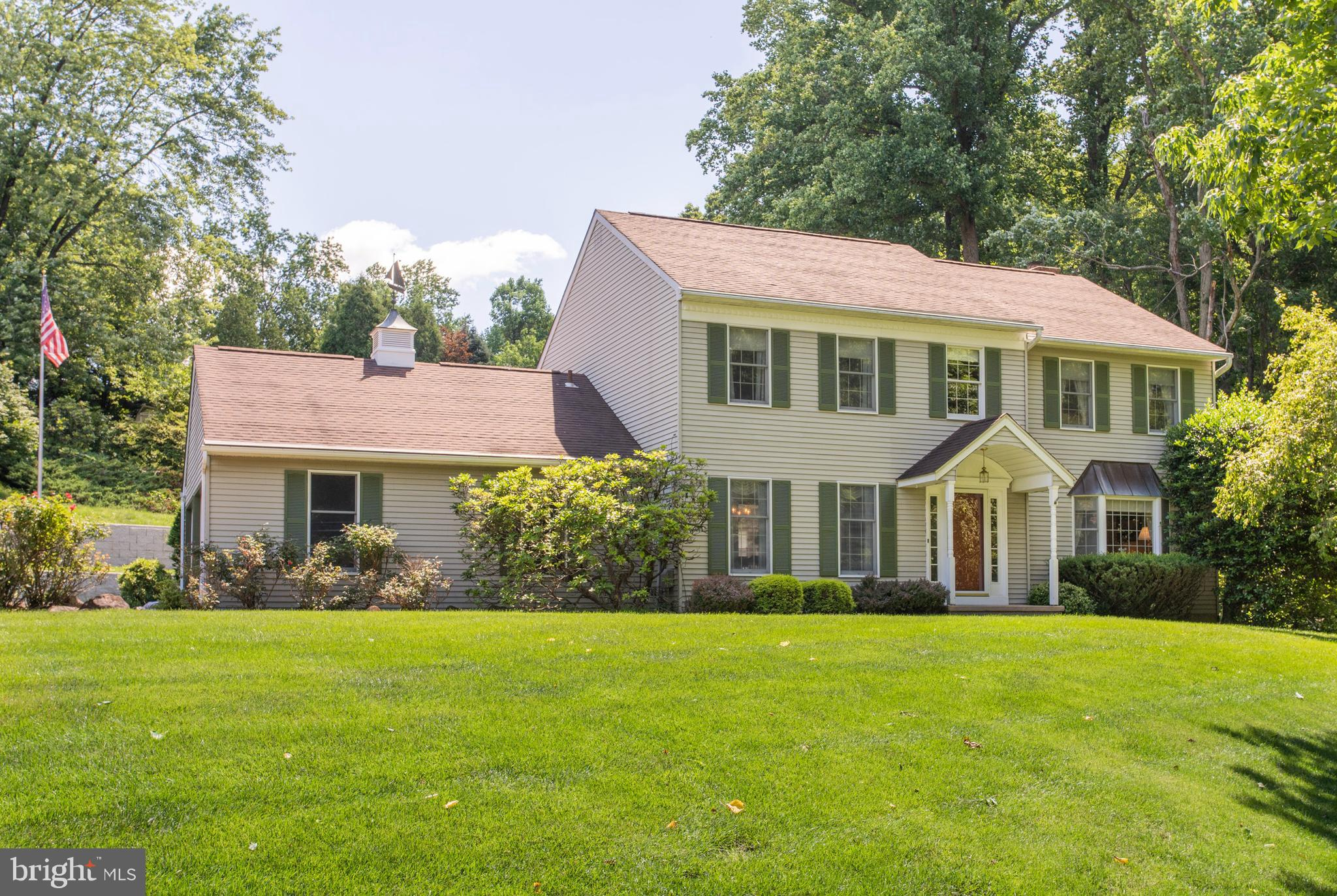 """Welcome to 154 Poplar Road! Located on a quiet cul-de-sac in the much-desired Newtown Woods area of Newtown Square and perched majestically atop a beautifully maintained front lawn, surrounded by mature trees, shrubs, and gardens, it will be love at first sight! Walking through the front door and into the formal foyer, you will immediately be struck by the bright, open feel of the home. The living room, with an expansive bay window, is just waiting for your guests to arrive. Next notice the large, lovely dining room, which is perfectly designed for entertaining. The kitchen is light and airy with a bonus island for extra counter space. The openness of the connected breakfast area leading to a warm cozy family room makes this house stand out. Notice the words painted on the beam to show the love that has been in this home. With a working propane fireplace, built in bookshelves, and French doors to the deck, this will be the room you will settle in at the end of the day. Completing the first floor are the mudroom/laundry room, which are perfectly situated off of the kitchen, leading to the 2-car attached garage. Upstairs, the master bedroom is your first stop. Bright and warm, this room offers a huge walk-in closet with a laundry chute down to the laundry room! What a bonus!! The large full bath completes your master suite. Down the hall you will find 3 other full-sized bedrooms, and an extra-large hall bath - all generously flooded with light. The basement is dry and clean with a French drain, bar, workbench, and a """"cold cellar"""" for storage. The high ceilings and large footprint are just begging to be turned into something spectacular! Step outside to grounds that have been lovingly and meticulously maintained for many years, with plenty of grassy areas for play and entertaining, and a stream to dip your toes in. You will notice right away the enormous and extensive hardscaping of the retaining walls with three different levels, each boasting its own special charm. T"""