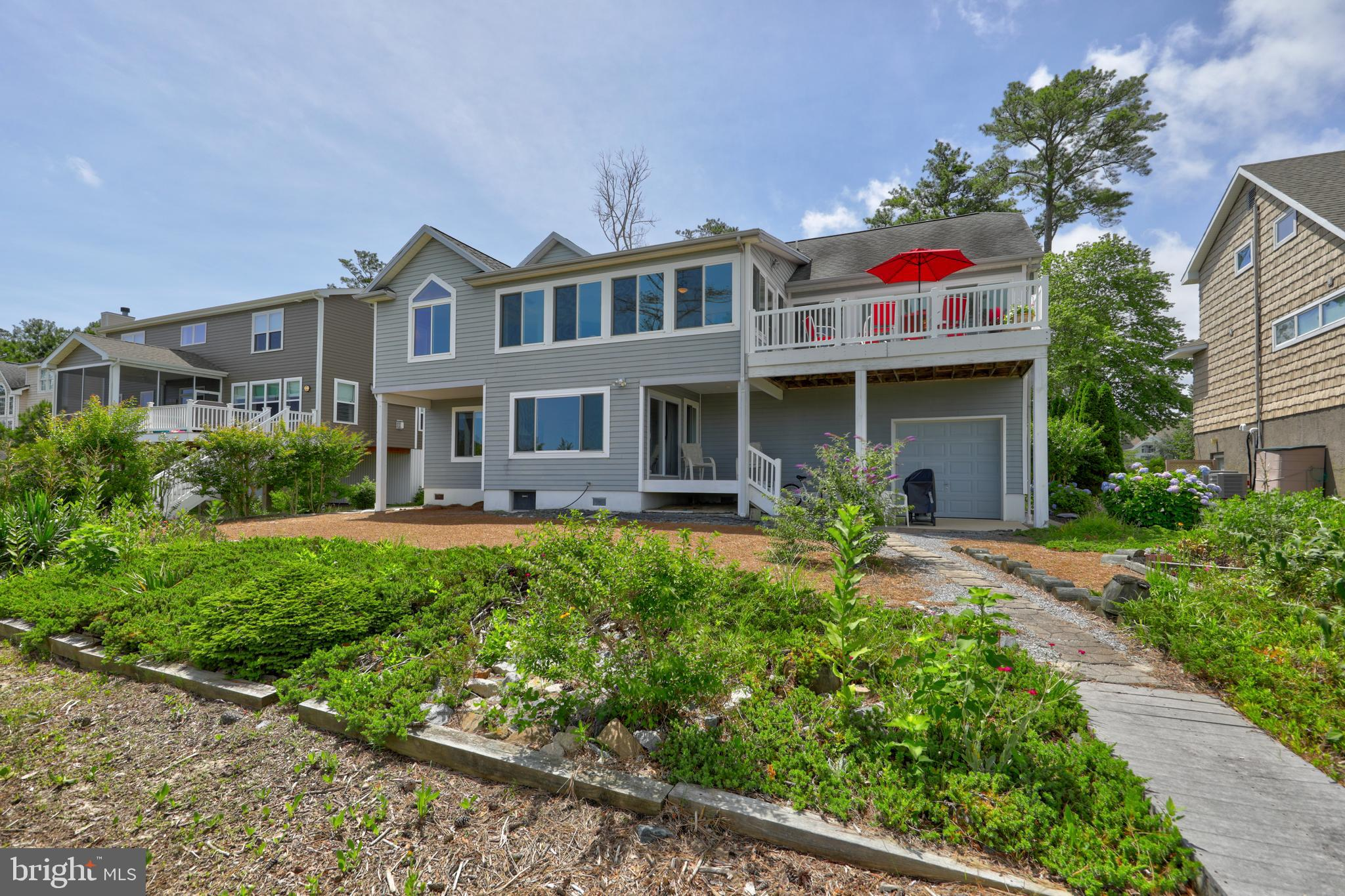 Custom built  Coastal Home in the  waterfront community of Cedar Landing in Ocean View. This meticulously maintained home is  located on a waterfront lot with a private dock and boat slip.  Panoramic views of the Whites Creek from the living room , sun room, master bedroom suite, decks, dining room and kitchen!  The  home is still occupied by the original owners . Enjoy  the beautiful backyard oasis, the ospreys and  the herons that  dwell in  THE  ISLAND of Cedar Landing.  Home features  4 bedrooms and 4 baths. First floor of the home is set up for an  in-law suite complete with 2 bedrooms,  kitchen area, living  room and laundry with utility sink.  Take the ELEVATOR to the Second Floor where you will find  a sunny open floor plan  with vaulted ceilings, fireplace with built-ins,  hardwood floors, sunroom and deck  that  has  water views in every direction.   The owner suite includes a  large bedroom with a sitting area, large walk-in closet and owners' bathroom with a jetted tub and shower.  Owner's suite and 4th spacious bedroom are located to the right as you come in the large entry way from the front entrance of the home. Dock your boat or jet ski, put in your crab traps for crab feast later on. Relax on the decks or in the  sun room and enjoy beautiful sunsets in your new Salt Life!