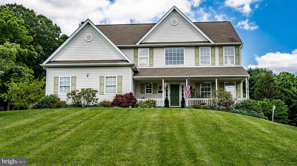 """If you're looking for A Turnkey Home in Downingtown Schools, Look no further.  Located in Glenmoore, where Chester Springs, Downingtown and Glenmoore meet, lies this Modern Colonial which shows Pride in Ownership.  This Center hall impresses from the front door. You'll be welcomed by Wood floors with a landing, which overlooks the homes entrance from above, bringing the wood floors up the stairs case and through the upper Hallway. Made for entertaining, this home has a floor plan which flows.   As you continue, wander into a large, eat in kitchen with 9' Ceilings, Cherry Cabinets, Easy Care Corian Counters and Matching Center Island, Travertine Natural Stone Backsplash, Under the Cabinet Lighting and, to round it all out, Kitchenaid appliances.  The space flows even further into a Large Family room with a wood burning fireplace surrounded by a large wood mantle with glass tile.  The Floor here is a Durable, Easy Care Faux Wood Porcelain Tile.  If you're in need of more space, the other side boasts a formal Dinning Room and adjoining Living room Area but can be easily repurposed to fit your needs.  Upstairs you'll find a Massive Owners Bedroom Suite which Includes a 10' X 12' Sitting area.  Although presently used as home office, it could be a nursery or Private TV room for just the """"Rents"""".  The Owners Bath continues to impress as you walk into your own private Spa.  Tiled in Carrara Gris Marble Look Tile and accented with Walker Zanger """"Spa Glass"""" mosaic glass tile, you'll enjoy your morning ritual or your evening soak in the soaking tub.  Truly a room to be enjoyed.  This Bedroom also has a Large """"walk thru' Closet and there is an additional (10'X10')  space available which can be finished into a walk in dressing room if you desire. Plenty of room abounds with  3 Additional Bedrooms upstairs (All Bedrooms have newer Neutral Carpeting with Tempurpedic padding…comfy yes) and a Hall Bath with Tiled Floors, Wainscoting and a Skylight to let the natural light in.   Bac"""