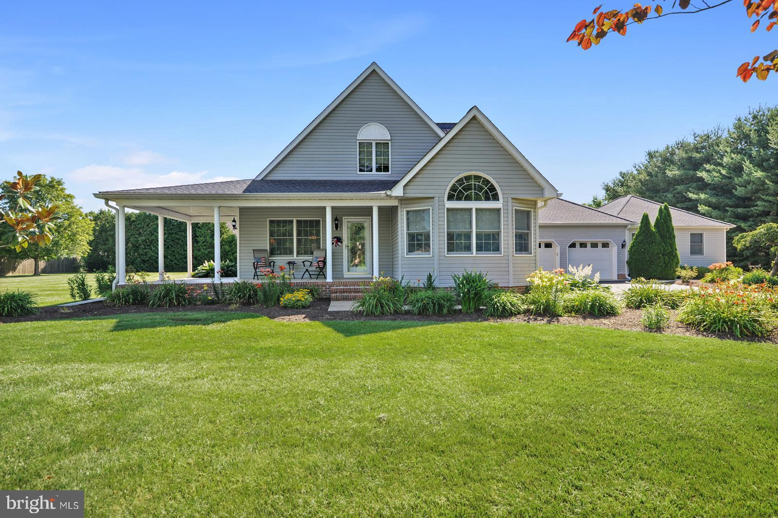 Country living close to city convenience! Pride of ownership shows in this lovely sprawling 1.5 story home on a wonderful 1 acre lot with tons to offer. Take notice of the two-story ceilings that create a welcoming entry to the home into the formal living room that features a gas fireplace. Continuing on you will enter the very spacious and warm country kitchen with beautiful hardwood floors, 42 inch solid oak cabinets, plenty of counter space, built-in wine storage, recessed lighting, a peninsula with space for additional seating and a pantry. The dining area is attached to the kitchen and has a beautiful bay window overlooking the side yard. French doors lead you to the bright den/office, and the cozy family room that overlooks the inground pool, beautiful landscaping and backyard. There is a sliding door in the family room to access the backyard. Just off the kitchen is access to the laundry room and half bathroom. Also on the main level there are two spacious secondary bedrooms that share a full hall bathroom. Upstairs the large private master bedroom boasts cathedral ceilings, attached full bath, and loft/retreat area. This home has a dedicated workshop that was added in 2005 in addition to the two-car garage. The workshop has a gas heater, ceiling fan, pull-down attic access and plenty of space for storage. The backyard is a true oasis with a personal inground pool and expansive decking around the pool, perfect for entertaining and relaxing with friends and family. There is an owned water conditioning system, new tankless water heater (2020), 12'x24' shed, a driveway extension and RV pod that were done in 2010 - perfect for a 35' RV. The roof was fully replaced in 2017 and has a transferable warranty for the next owners to receive. These are only a few of the many features this home offers! Schedule your tour today to visit this beautiful oasis, you don't want to miss this opportunity!