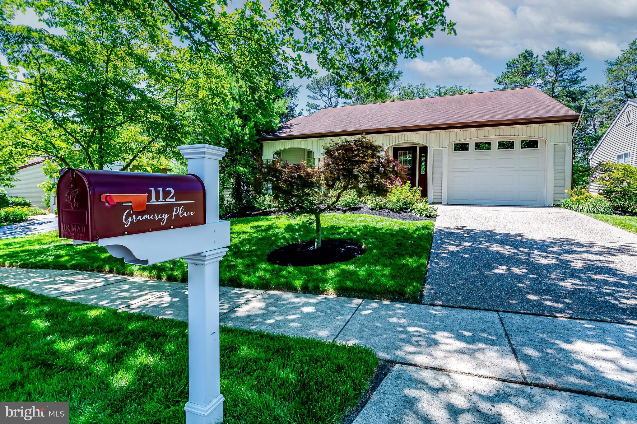 Absolutely Fabulous, Desirable Fairfax model boasts 1728 sq. ft of Stunning Living on a Quiet, Tree-lined Street.  As you walk up the River Stone Driveway and past the Dogwood and Japanese Maple Trees, an Inviting Front Porch and Bright Front Door leads you into this Beautifully Updated and Lovingly Maintained Home.  What captures your attention is the Custom Four and Six-inch Craftsman Millwork around all the Windows and Baseboards.  The Wonderfully Appointed Spacious Living Room seamless flows into a Dining Room with Chair Rail and eye-catching Chandelier, perfect for Elegant Dining. As we move into the Custom Kitchen with Lovely White, Soft-Close Cabinetry with Gorgeous Glass Front, Back Lighted Dish Cabinet and Convenient Drawer Cabinetry with Under-Cabinet Lighting that showcases the Gleaming Granite Countertop with Under-Mount Sink. All are enhanced with Pristine Subway Tile Backsplash and Complimented by the Stainless Steel Appliances. Warm, Wood Laminate Flooring runs from the Kitchen into the Breakfast Area and Large Family Room that Features California Wood Shutters, an Electric Fireplace with Mantel, a true Showpiece of this Room.  Sliders lead to an Inviting Patio that can easily accommodate a Gathering also offers Calming Views of Greenspace. Back inside, the Hallway, replete with Graceful Custom Board and Batten Walls invite you toward a Stunning and Spacious Primary Bedroom Ensuite with Sliding Barn Doors that lead to a Dedicated Primary Bathroom with Walk-In Tiled Shower and Floor. Custom Lighting over the Dresser Cabinet with Marble Vanity Top, provides that coveted counter space. It's sure to be appreciated by those with Exquisite Taste. The Main Bathroom will be admired by your Guests given the Tile Flooring, Tasteful Vanity and Mirror. The Bright and Airy Second Bedroom, which can serve as a Guest, Office or Craft Room has Floor to Ceiling Mirrored Closets. Additional Floor to Ceiling Mirrored Closet Space and Spacious Pantry are located in the H