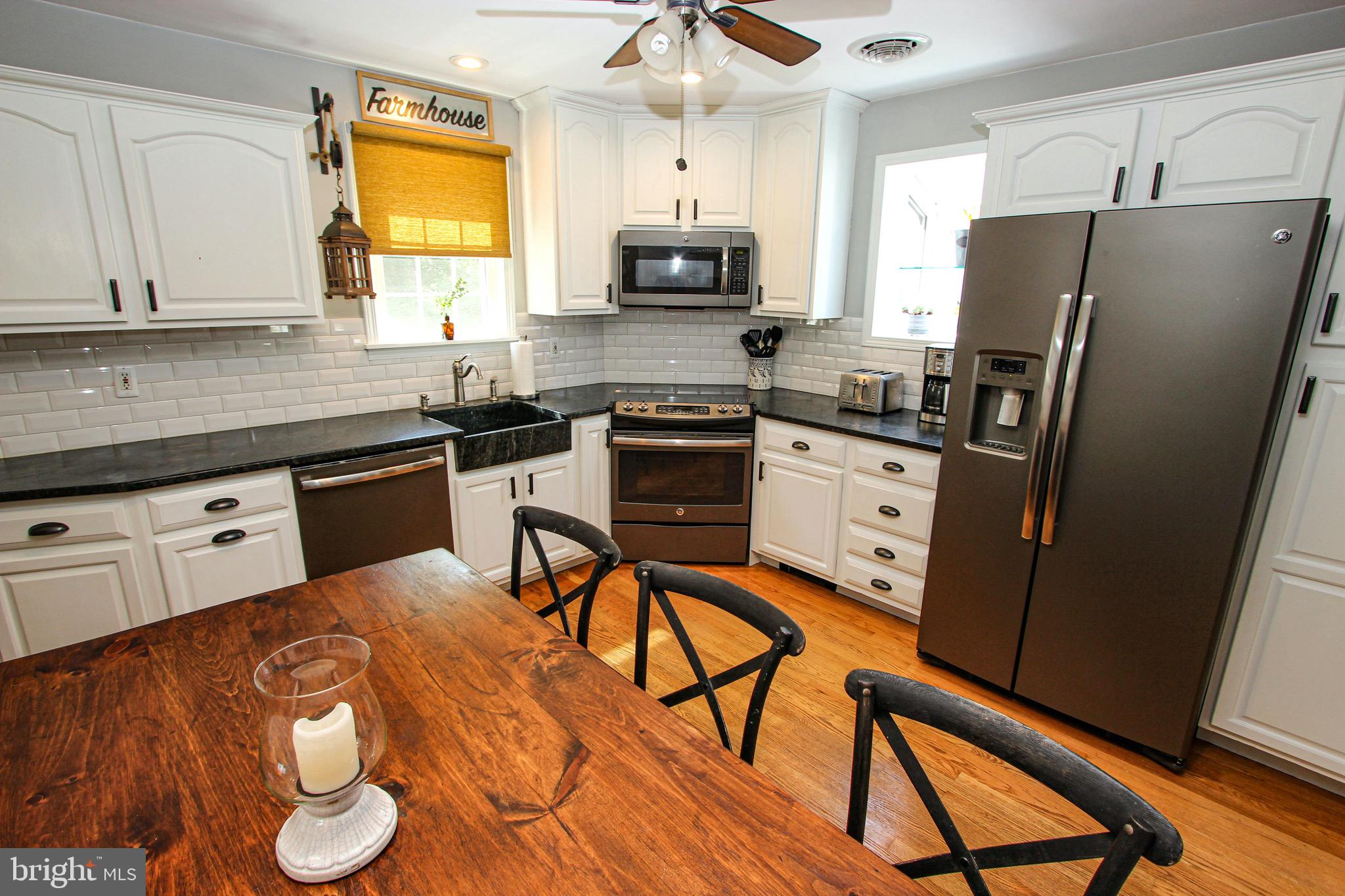 """Pristine Solid Brick Ranch!  You must see this Home! it is Not a Flip but Love and Care Over Time!   There  has Only been Owned by this Family.  Owner's Parents were the Original Owners and Daughter and Husband bought from the Parents. Lovingly Maintained and Improved through the Generations.   Hardwoods throughout the Main level and  Remodeled Farmhouse Kitchen with Expansive Updated Cabinets, Soapstone Solid Countertops, Accented with a Farmhouse Style Sink, Subway Tile Backsplash, Greenhouse Window, Corner Ceramic-Top Range with Built-in Microwave above and Stainless appliances which are included.  Out of the Kitchen Door to the 15 x 28 Patio that Overlooks the Vinyl Fenced Yard Backing to Wooded Parkland!  The Family Room in the Basement Also Walks out to the Serene Backyard and Patio. 19 ft x 31 ft Family Room is Perfection with New Vinyl Plank flooring, Recessed Lights, Exposed Wooden Beam, Stone Accented Columns and Electric Fireplace.  Then to the Unbelievable Full Bathroom with Vinyl Plank from Floor to Walls to Ceiling with Walk-In Shower with Glass Enclosure, Dry-Sink Type Vanity and Wash Basin with """"Well Pump"""" Type Fixture.  Upstairs to the Open and Bright Living Room down the Hall to the Remodeled Full Bath and 3 Bedrooms. Every room in this home is Perfect.   Economical Natural Gas Baseboard Heat and Central Air Conditioning.  This Home is Exceptional!  Hurry to make it yours!  Showing are for 3 days, starting Thursday,7/1 to 7/3.  Hurry to secure your Time slot."""