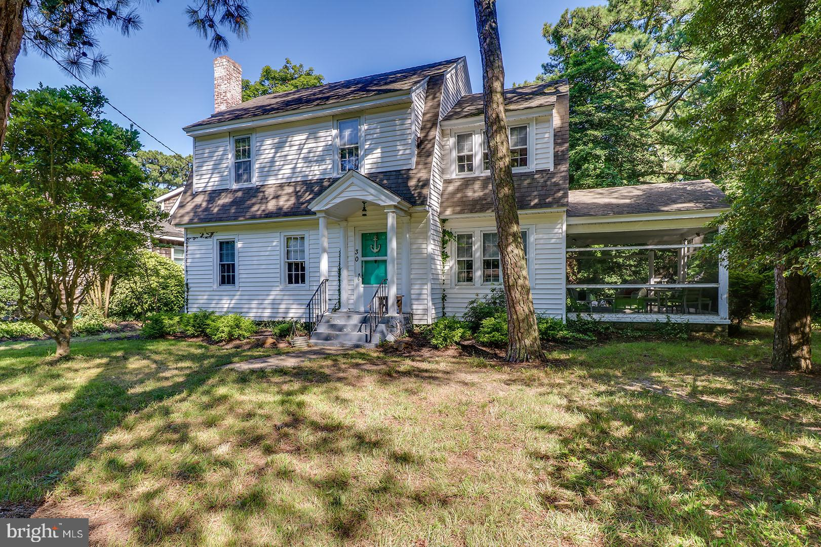 Rare opportunity to own a 75'x 100' parcel on one of the most sought-after locations in The Pines - Park Avenue.  Perfectly positioned in the ocean block and just a short distance from the beach. This location offers excellent proximity to the boardwalk, restaurants, and all of Rehoboth's amenities. This 1930's cottage is surprisingly spacious and offers great potential. Upon entry the home features a large family room complete with a wood burning fireplace and high ceilings for a home of this age.  Adjacent to the family room you will find a large flex space that is currently being used as a 5th bedroom, but appears to have been a study or den in the past.  As you walk to the rear of the home you will find an eat-in kitchen that connects to a large formal dining room.  A beautiful curved staircase decorated with an intricate railing guides you to the second floor where you will find 4 spacious bedrooms, a full bath and a walk-up attic. With a screened porch, beautiful mature trees and a detached garage, 30 Park Avenue offers many possibilities, but most important, a superb location!