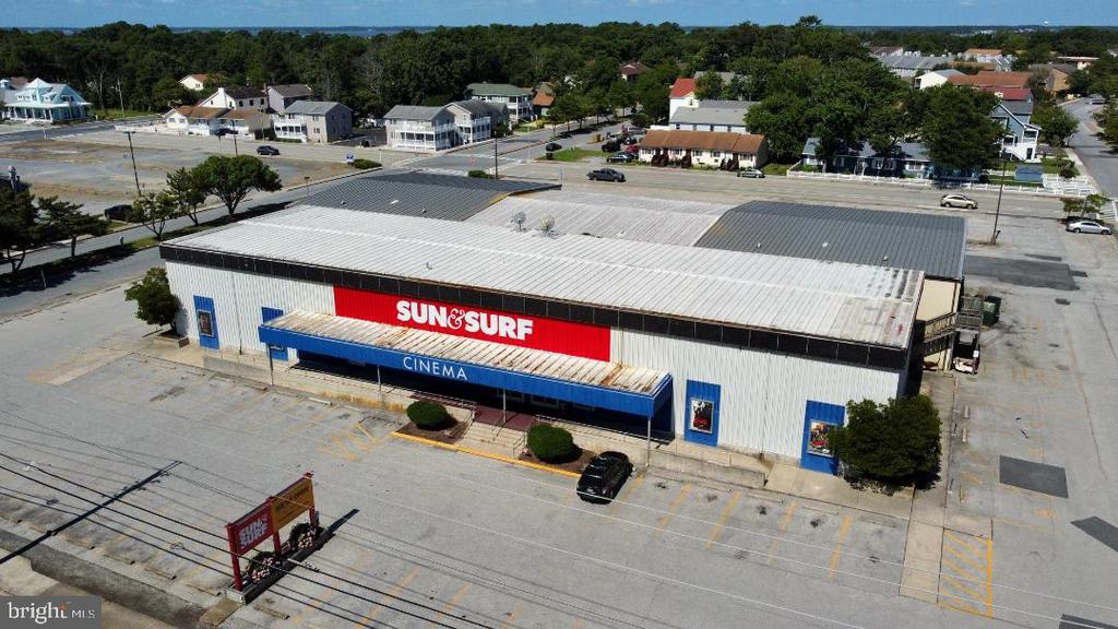 We are proud to offer for sale the Sun & Surf Cinema property - a developer's dream - located on the Coastal Highway at 143rd Street in Ocean City, Maryland. Built in 1971, and expanded in 1975 and 1983, the 8-screen movie theater underwent an extensive renovation in 2015, highlighted by the installation of 712 luxury recliners. On the development side, the commercially zoned site consists of 2.37 acres, with 300 feet of frontage on Coastal Highway. The movie theater building is approximately 23,734 sq. ft. Given the property's size and its key location, the opportunities for redevelopment are many. Please note that this is an operating movie theater and all showings are by appointment only and must be accompanied by the listing agent. A recent survey is available upon request. Please call or email with any questions.