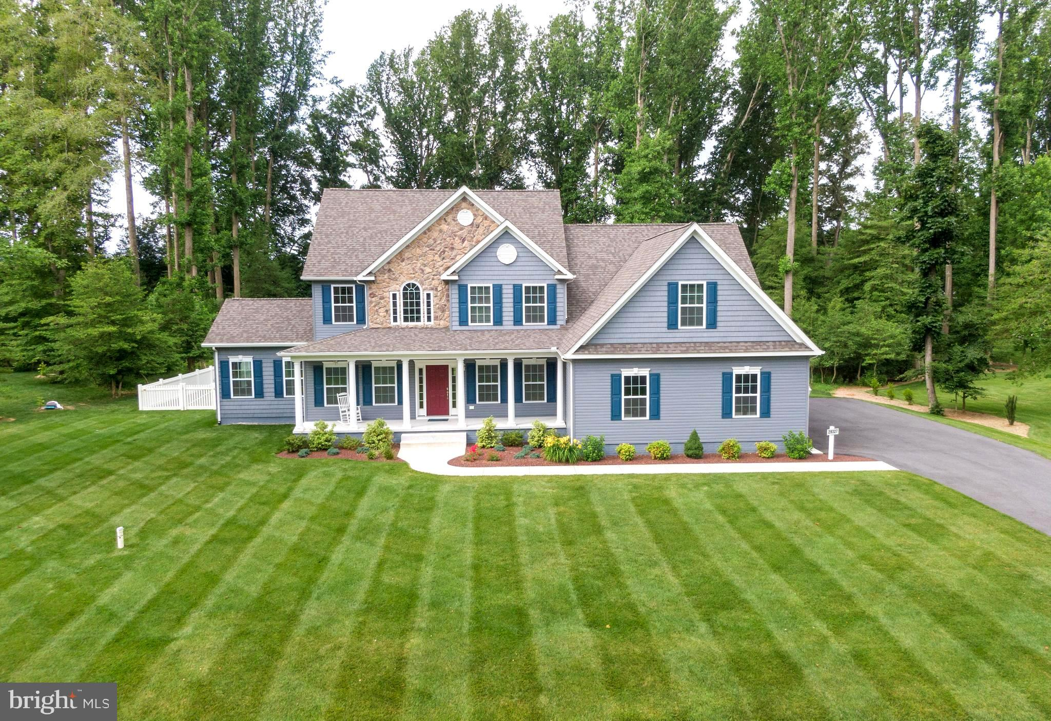 """Nearly new and no wait! This spectacular home on an acre plus is under 3 years young,  barely lived in and provides spacious living both inside and out.  Located in a peaceful, wooded cul-de-sac in River Rock Run where folks come to enjoy coastal living with the beauty and privacy of large lots.  Surrounded by gorgeous homes in pretty settings themselves, this one still stands out as you come down the street. Well manicured and irrigated lawns within the shade of tall trees enhance the striking contrasts of its stone accents and siding details all contributing to the elegance of this well thought out home.  The home was bumped out 2 feet to the back enlarging the kitchen and primary bedroom and also 2 feet to the side enlarging the primary bedroom again and the garage which took it to over 1000 square feet. Plus you will be wowed by the immense second floor bonus room complete with full bathroom on the second floor that could be another bedroom suite or a great place for house guests to sprawl out. (The owner wants to be sure I mention there are 15 closets in the house too,) And if you need more storage for your big toys, tools and other and equipment, this home is on an exterior lot which means you could add a 30x30 detached garage or large shed up to 14x28.  Just make sure you don't put it where you would install your new pool if you want one because they made sure there was room in the yard for that too. (See the septic layout in the documents). The extra height in the clean, dry basement with outside entrance taking it to 9 feet and rough plumbing for a powder room should get your mind into high gear thinking about all the ways you could turn that space into a gym, media room or just a full blown recreation area.  Well designed kitchen with stainless steel appliances, 42"""" cabinets and granite countertop with angled breakfast bar open to the great room lets you be part of what's going around you while putting together your next great meal.  The professional pictu"""