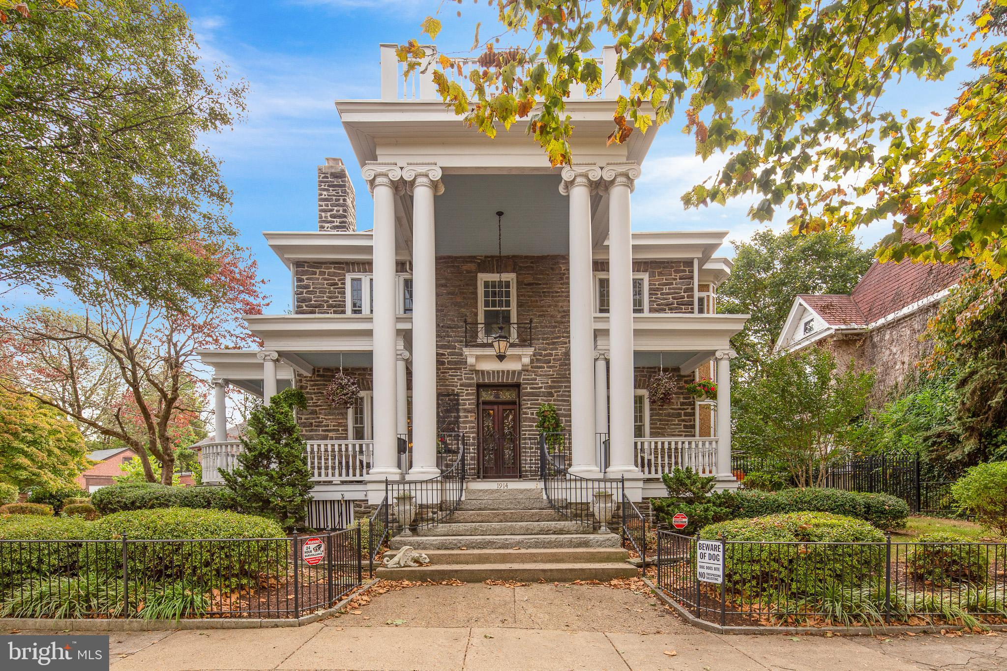 Don't miss this opportunity to own the historic 'Topkis' home built in 1900 on 'The Boulevard' later renamed Baynard Boulevard in 1925 after its chief developer, Samuel H. Baynard. Many of those grand homes have since been torn down but 1914 Baynard Boulevard, the second home to be built on The Boulevard, endures as a stone and mortar testament to Mr. Baynard's vision for a new, prestigious neighborhood. This magnificent home is easily identified by the massive columns, multiple decks, and a wrap around porch enclosed with a wrought iron gate.  The timeless grandeur and elegance found in such a historic home is apparent from the moment you cross the threshold through the custom front doors and matching transom. Enter into the foyer and appreciate the grand living room with a welcoming fireplace, crown molding, and gracious lighting fixtures.  Through the French doors on the opposite side of the foyer is a charming music room with abundant light which could easily be used as a home office or formal sitting room and includes a small deck off the side door.  With a three-window bay, the elegant dining room offers plenty of natural light and leads through French doors into the sunroom with radiant heated tile floors and includes a small sink alongside the powder room. One side of the sunroom opens to a small south-facing deck, ideal for a potted garden area and opposite are the Anderson doors to the covered deck, which is also accessible through the kitchen and leads to the professionally landscaped backyard, complete with a large gazebo, custom hardscaping and stone seating wall and an abundance of yard space.   Between the dining room and the kitchen is a charming butler's pantry with glass front cabinets, a wet bar, and a bonus dishwasher along with a pantry providing plenty of storage. The kitchen boasts commercial grade stainless steel appliances including a six-burner Dacor range with custom hood, and a double door Subzero refrigerator as well as recessed lighting
