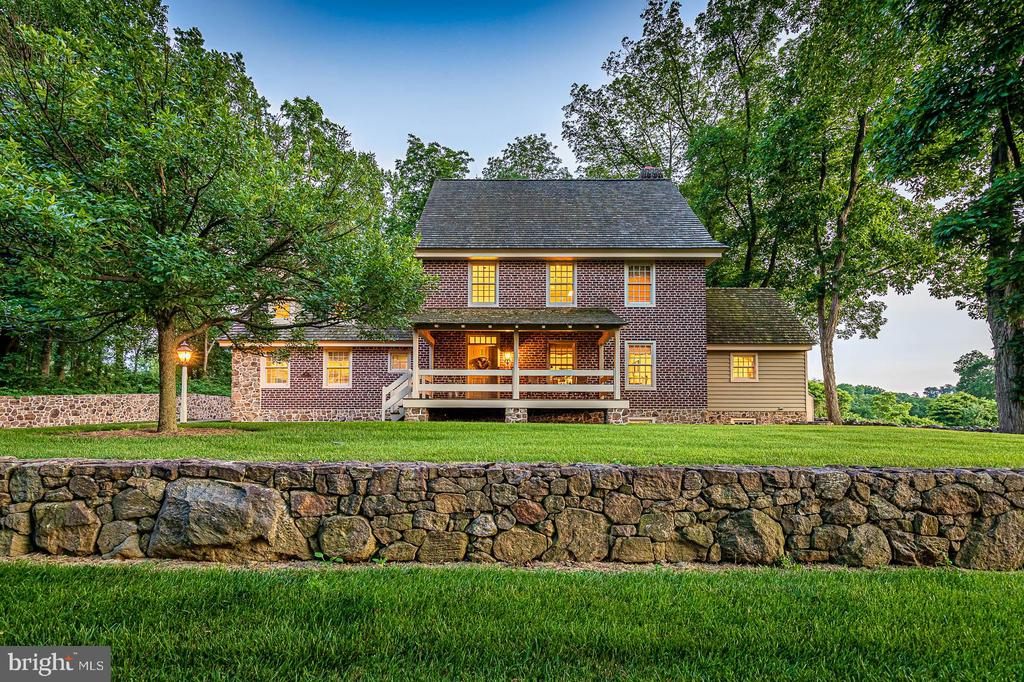 """The Brick House--aptly named for its exterior use of hand-made bricks—was meticulously constructed by award-winning builders Stoltzfus Enterprises. A stone wall anchors the home and gives the appearance of an original fireplace of early 19th century homestead in the settlement of Olde Bulltown Village. Custom elements like clapboard siding on the two-car carriage shed, copper gutters and down spouts, as well as cedar shake shingles demonstrate the commitment to excellence. Inside, the attention to detail continues with beaded siding, quarter-sawn oak flooring, granite countertops and custom millwork. In addition to the design and fine craftsmanship of the home itself, the home site contributes to the uniqueness of the home. Situated on a partially wooded lot to the north of the fourteenth hole at the French Creek Golf Club, the Brick House enjoys spectacular sunset views from the open kitchen and every outdoor space. This Pyramid Award winning """"Custom Home of the Year"""" combines simple elegance and utility-minded design with its first-floor master suite, great room and kitchen, along with multi-zoned geothermal heating and cooling. Lawn maintenance, snow removal and common space care services are provided by the Brownstone HOA.  With so much to offer in such a grand setting, a visit is the only way to truly appreciate this property."""