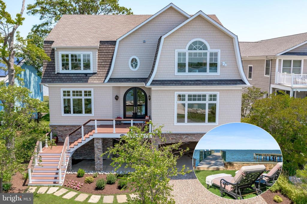 If you love big views of the Chesapeake Bay, this is the home for you! A rare opportunity to live in Annapolis and experience the vibrant nature of the Chesapeake Bay from an exceptional luxury residence. This gorgeous home is perfectly aligned for you to wake up to the sunrise sparkling on the Chesapeake Bay Bridge. Views of Thomas Point Park and Fishing Creek provide sunset celebrations to the west. Your boats will come and go from Two docks - one on the Bay side and one on Fishing Creek with a lift.  Both docks and shorelines are fortified with stone revetment and a concrete bulkhead on the bay side.  Massive waterfront views will blow you away as you step through the elegant, curved double front doors.  Your eyes will follow freighters up the bay, boaters in search of fish, and paddle boarders heading out to Thomas Point Light.  Early morning crabbers will check pots with the sunrise behind them. The main living quarters are built 14 feet above MLW.  The great room ceilings are 10' and finished with crown molding.  The family area has a beautiful gas fireplace surrounded by granite and an elegant mantel. The entire main level has wide plank oak flooring.  Generously sized home office or guest bedroom on the main level with a full bath and built in shelving.  A versatile and light-filled room with a french door entry allows you to have a second home office, play space, den or dining room.  The upper level has four generously sized, light-filled bedrooms with vaulted ceilings, en suite baths, walk-in closets and separate laundry room.  The Primary bedroom offers a private deck with Bay views, a gas fireplace and an updated Primary Bath with Bay views, heated floors, a soaking tub, a marble shower with steam, custom vanities and private water closet. Lower level entry offers a mud room off of the covered parking.  Bay-side deck and covered patio and  yard for entertaining. Two storage rooms on ground level. Whole-house & pier, elevated generator.  Water views aboun