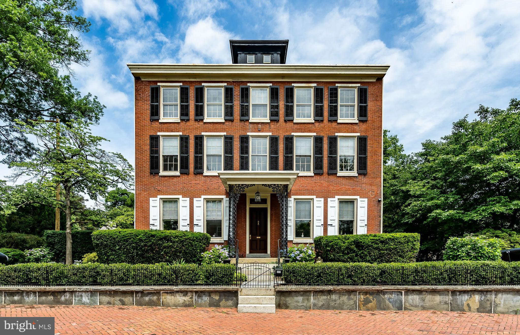 """This Majestic Federal Colonial offers secluded professionally maintained grounds. Mature trees, shrubs and plantings adorn this property, which is surrounded by wrought-iron fencing and gates. One of the most sought-after neighborhoods in West Chester Borough. West Chester Borough has been named in many publications as """"One of the best small towns in the country"""". One block walk to """"Marshall Square Park"""". Marshall Square was West Chester's first park and Town Square in the borough. Some of the amenities of the park are a play-ground, Gazebo, basketball courts, water fountain, and plantings for the botanist enthusiast, and many historical references on Marshall Park's website. Just walk a few blocks and you're in the center of town. This incredible brick built home circa 1872, has all the ambiance, charm, character and elegance one would expect and yet all the modern amenities required in today's homes. This amazing 3 story home even has a """"Widows Walk"""". Although there is no need to view incoming ships from the Delaware, this adds to the allure of the home. Enter through the front portico into E/H, Beautiful Wooden staircase faces you. To the left is a relaxing Lr. ( 22 x 14.6). Lg entertaining Dr. (22 x 14.6) equipped with a gas fireplace and seating for at least 12-14 people. O/e from the Dr onto the main floor Veranda ( 16.7 x 8.1) w/ ceiling-fan. Secluded area to enjoy and relax. Gorgeous kitchen ( 16.6 x 11.2) w/ Viking appliances, breakfast-bar seating for 3. Directly across is the breakfast-room ( 16.5 x 10.3). Rear staircase to the 2nd floor office is accessed from this room. Full 1st fl bathroom (11.7 x 7.3) including stall shower. Adjacent to the bathroom is the laundry-room (11.10 x 7) w/ granite topped sink and additional cabinets for storage. A Vestibule (7.3 x 7.8) separates these two rooms. Level side and rear yard leads to a 5-car detached garage, and 3 side driveway parking spaces. Total 8 parking spaces! Yes you read correct very few homeowners in t"""
