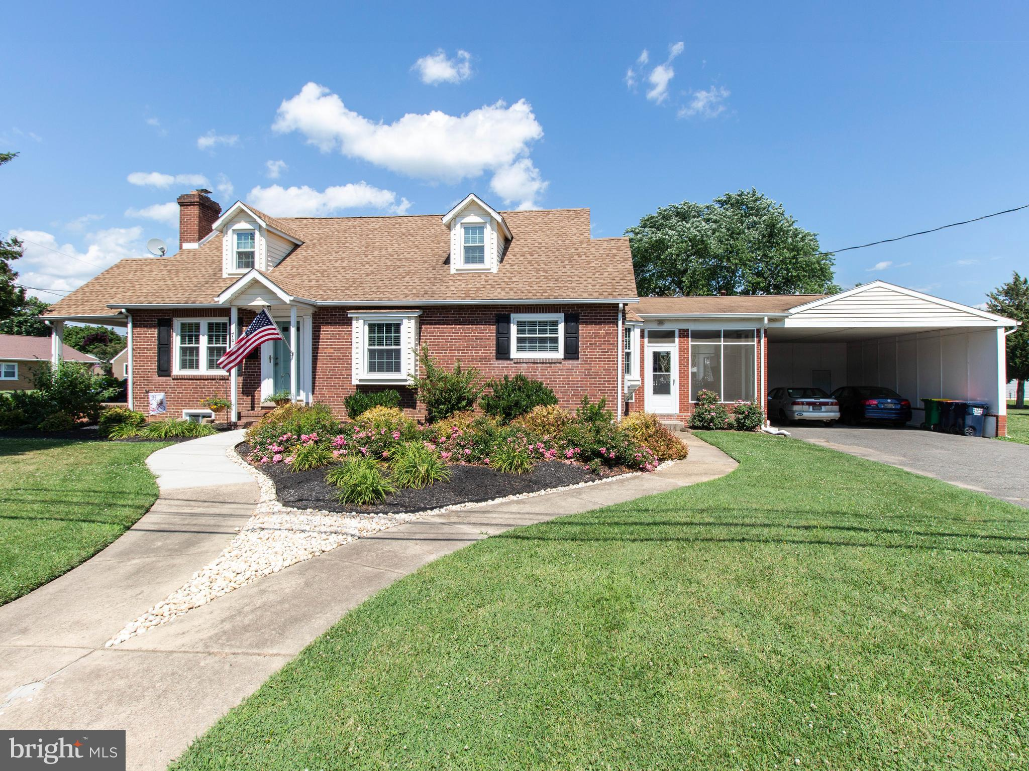"""Beautifully updated 4BR/2BA Cape Cod on a spacious 0.36 acre corner lot in the heart of Middletown and within walking distance to several Appoquinimink schools, Main Street shopping, and all that downtown Middletown has to offer.  The stately brick exterior and lush landscaping are accentuated by the split sidewalks leading up to the front of the home where you have 2 covered entrances to keep you out of the elements.  This home has been almost totally updated over the past 10 years with a modern open-concept kitchen, 2 renovated baths, architectural shingle roof, new windows, new furnace, and attractive paint throughout.  Gleaming hardwood floors adorn the living room, dining area, hallways and bedrooms.  The renovated kitchen boasts 42"""" shaker style cabinets with crown molding, stainless appliances, a peninsula with bar seating, granite counters and tiled floors and backsplash and opens up to a bright and cheery living area with a wood burning brick fireplace.  Both bedrooms on the 1st level share an updated hall bathroom and there are 2 more bedrooms and a flex space on the upper level that share another renovated 2nd level bathroom.  There is also a semi-finished walk-out basement with a bar area and plenty of storage.  The outdoor living space off the kitchen expands the charm of this home!  You can enjoy bug-free evenings on your spacious screened in breezeway complete with epoxy-coated floors, ceiling fan, new lighting and a brick grill.  If you want to enjoy a little more sun, you can head out to a newer Trex deck overlooking a wonderful backyard area with a rose of Sharon and crepe myrtle border.  There is also a convenient enclosed 2-car carport which could easily be converted to a garage with the addition of overhead doors.  It provides a huge covered space in addition to parking for 4 vehicles in the driveway.  This home's modern updates and convenient location make it a must-see if you're looking to find a home in the Middletown area!  MAKE THIS YOUR NE"""