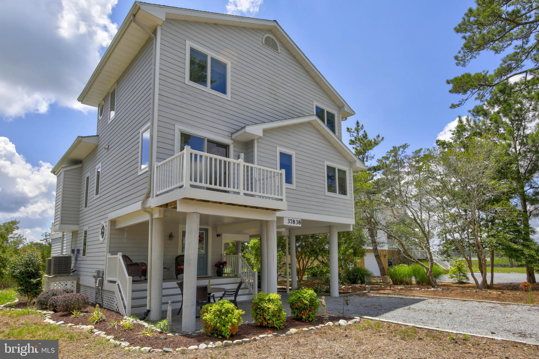 COASTAL. SPACIOUS. BEAUTIFUL. This fabulous four-bedroom, three bath home is nestled among the natural beauty of the wetlands and Bay in the much sought-after waterfront community of Cedar Landing. The outdoor decks provide fabulous views and the private walkway takes you to the water. The home features a reverse floor plan with a foyer and bonus room on the lower level. The open floor plan on the main level boasts high ceilings, a year-round sunroom, and a deck with an attached awning which provides a wonderful shaded space for living, relaxing, and entertaining. The tiled kitchen has updated stainless steel appliances and features ample dining space. The large bedrooms are light and airy and the master bedroom has a beautiful private bath. The wonderful loft area on the upper level provides additional living space for entertaining and the two bedrooms are spacious and private. The home also has a large outdoor shower and a secure shed to store all your beach gear, bikes, etc. The Cedar Landing community has easy access to a private residents' boat ramp for powered boats, kayaks, and personal watercraft in addition to a pool and tennis courts. Truly resort style year-round living in a secluded beautiful community that is close to Bethany Beach, restaurants, shopping, night life, and more. Make this your dream home today!