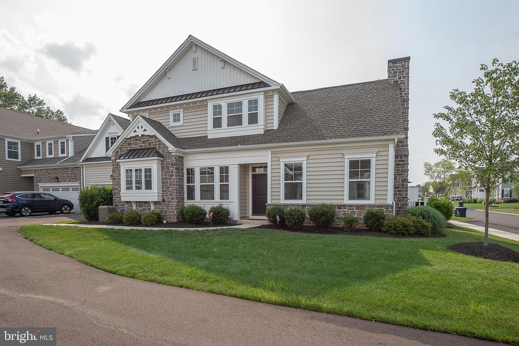 Welcome to 701 Summit Drive in the Club View at Spring Ford community. This lovely like-new townhouse is situated on a corner lot just one home off of the Spring Ford Country Club golf course. The front door opens into a large entryway that leads left to the dining room/kitchen area and right to the living room. The kitchen is well outfitted with lots of cabinets, granite counters, stainless appliances and an expansive island. The combined dining area offers additional room for a large dining table. Hardwood floors and high ceilings throughout the kitchen, dining room, powder room, mudroom and laundry. Vaulted ceiling and large windows light up the carpeted living room which includes a gas fireplace and entrance to a private Trex deck. The main bedroom finishes off the first floor. This bedroom includes a tray ceiling, carpets, large walk-in closet and large bathroom with double variety and huge walk-in shower with bench. The second floor includes two additional bedrooms, a den and the second full bathroom with tub. There is an additional unfinished room currently used for storage that could be finished as a fourth bedroom or office. Pass through the kitchen to the powder room, laundry room with new custom built cabinets and large mud room with custom built-ins both added by the current owner. The large two car garage offers rooms for cars and storage. Light and space abound throughout this home! The Club View at Spring Ford community features 84 carriage-style homes on 27 acres, adjacent to the prestigious Spring Ford Country Club and beautiful preserved farmland. HOA covers snow removal, landscaping, and common area maintenance. Why wait for new construction? Make your appointment today!
