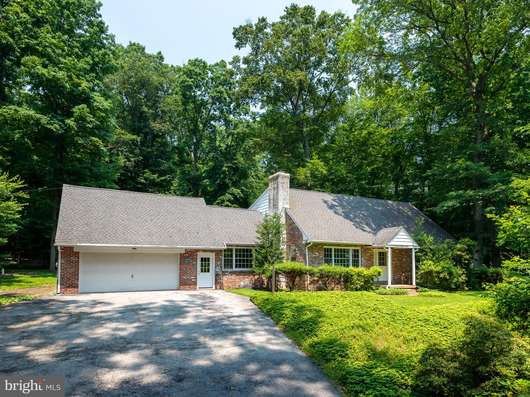 If you have been looking for a large, private, four bedroom home in the West Chester Area School district, your wait is over.   917 Warrior Road is situated on two full acres of land and within walking distance to East Goshen Park.  This serene, peaceful setting has a huge flat backyard that backs up to woods.  The deck is the perfect place for morning coffee and taking in the beauty of this natural setting.  Inside the house you will find a custom floor plan that has been upgraded.  As you enter the house,  the first floor living room is flooded with natural light.  The extra large galley kitchen is the perfect place to cook and eat meals while watching the beauty outside.  The downstairs has two bedrooms and a full bath, giving the option for a first-floor main bedroom.  Upstairs you'll find two additional large bedrooms, an enormous walk in closet and another full bathroom.  The original hardwood is in great shape and lends character to this special home.  The basement is partially finished and adds tons of living space.  There is also potential for a fifth bedroom downstairs, as well as so much more.  The creative buyer will fall in love with how much extra space the basement provides.   917 Warrior Road has 2 acres of land, low taxes, is extremely private, yet is still close to everything you love about West Chester.