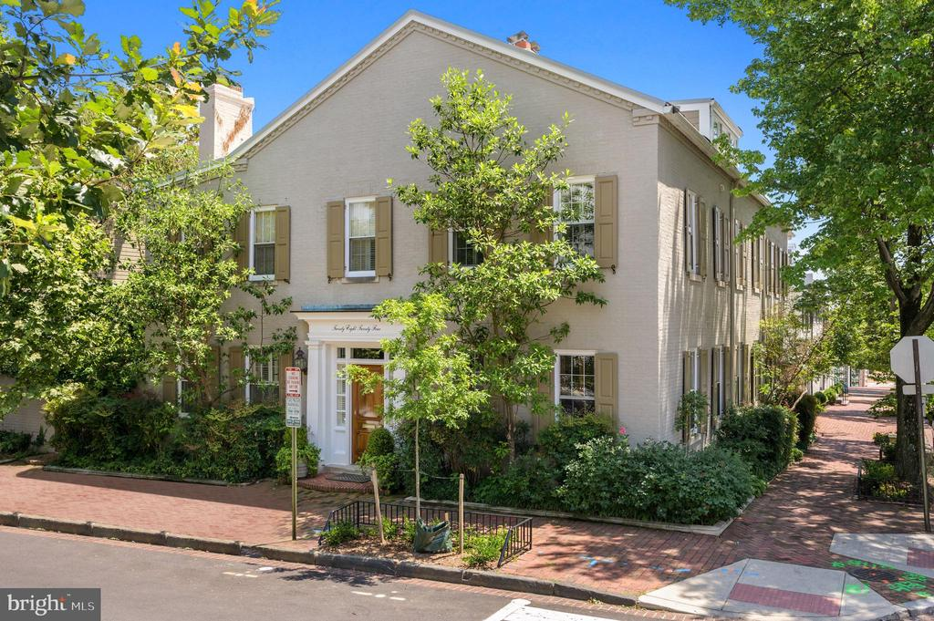 Incredibly rare offering  in Georgetown's sought-after East Village. This exceptional residence is a prominent corner compound featuring two separate, fully-detached houses connected by an elegant garden designed by Jame Van Sweden with pool and expansive entertaining patio. The main residence was decorated by Thomas Pheasant and features 5 Bedrooms / 6.5 Baths  plus a 2 car garage while guest house offers an additional 2 Bedrooms / 1.5 Baths. The elegant home offers grand spaces for large-scale entertaining, yet is well-proportioned for comfortable family living. First floor highlights include a double formal Living Room with two fireplaces, grand Dinning Room that easily seats 16 guests, sunny Family Room with garden views, sleek European style Kitchen with Miele appliances. Second level features a gracious Owners Suite with gas fireplace, marble bath and walk in closets plus 2 additional Bedrooms - both with ensuite Bathrooms. Top floor offers the 4th Bedroom /Bathroom along with extra storage. 5th Bedroom sits above the family room affording gorgeous garden views. Guest House offers the 6th and 7th Bedrooms plus 1.5 Baths as well as additional storage. Lower level features wine cellar, laundry room and additional storage. This prestigious home offers the discerning home-buyer everything and more, all within walking distance of Georgetown's vibrant and historic shops, restaurants, and waterfront.