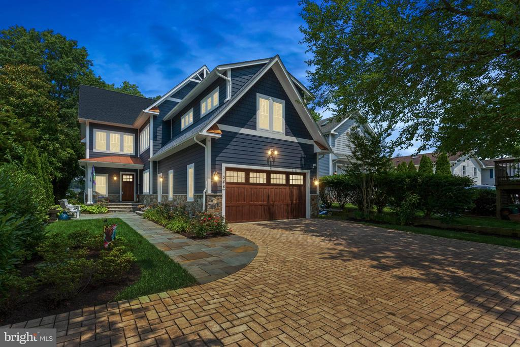 This stunning custom craftsman style home (built in 2018) situated on 3/4 of an acre of waterfront located on the Magothy River features 6 bedrooms, 4 baths, 3 fully finished levels and many, many upgrades including casement windows throughout the entire home, a whole house generator and security system.  The main level offers unbelievable water views with floor-to-ceiling windows, walnut hardwood floors, coffered ceilings and a bedroom with a full bath. The gourmet kitchen opens to the family room and boasts stainless steel appliances, gorgeous quartz countertops, gas stove and stacked stone fireplace with built-in cabinets.  Upstairs has 4 spacious bedrooms with 2 full bathrooms and a huge laundry room on this level.  The Primary bedroom has a vaulted ceiling, his & her walk-in closets, and master bathroom with an elegant standalone tub and large separate shower with upgraded shower heads. A lovely private porch is accessed from the master bedroom allowing you to enjoy your morning coffee while soaking in the fantastic water views. The finished basement has 1 bedroom with a full bath, home theater and game area.  The backyard makes this home complete with Ipe decking spanning the width of the home and an outdoor kitchen. The deep water pier with 12' depth has a 25,000 lb. capacity boat lift and two additional jet ski lifts and docking for 2 additional vessels.  There is a newly renovated guest cottage located on the property which is perfect for the in-laws or rental.  The cottage has 2 bedrooms, 1 bath, living area, kitchen and its own laundry room. Blue ribbon schools a plus!