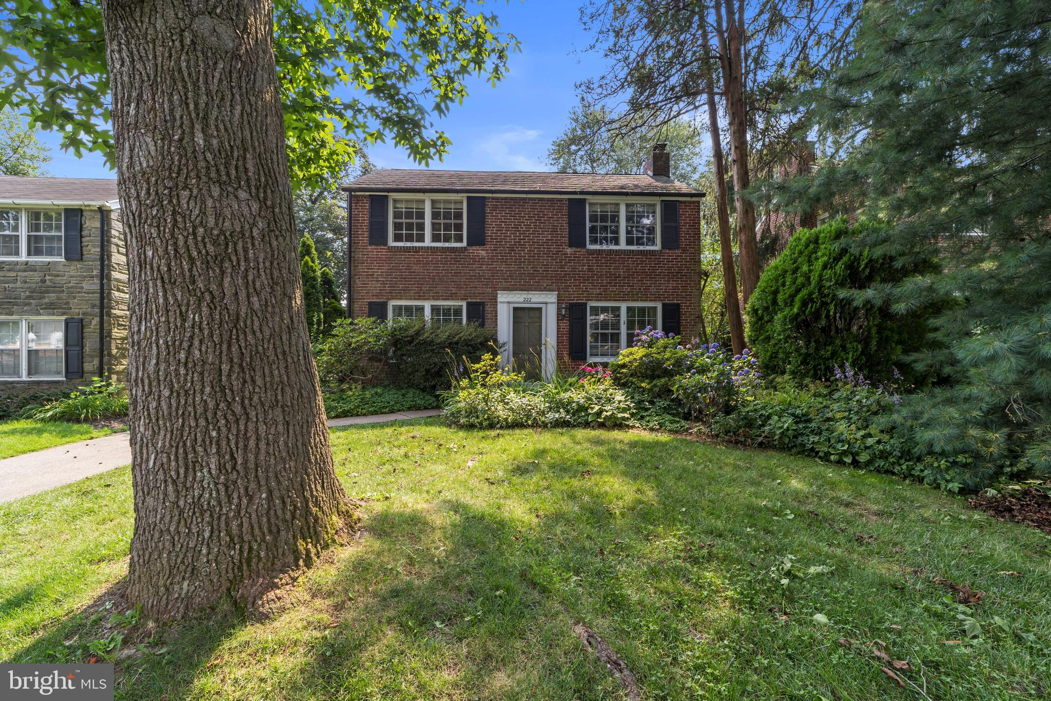 Come make family memories in this beautiful brick colonial peacefully situated in the highly sought after Penn Wynne section of Wynnewood. A short walk to the Blue Ribbon School of Excellence, Penn Wynne Elementary, the public library and the beautiful Wynnewood Valley Park, you will love life at 222 Harrogate Road. From the moment of entry you will be captivated by the appeal and charm of this home. Relax in the spacious living room with a wood-burning fireplace and built-in book shelves. Behind the living room you'll find the home office with views of the rear yard, or flex-space open to possibilities. To the left is the dining room open to the kitchen. You will love serving breakfast on the kitchen's breakfast bar. Off the kitchen you'll find the mudroom with plenty of built-in storage, a desk and cubbies. Step out the mudroom door to a paver patio and nicely sized rear yard, where you can enjoy bbq's and dinner al fresco.  On the second floor you will find the primary bedroom with a spacious walk-in closet, 2 additional nicely sized bedrooms, and an updated tiled bathroom. Pull down stairs lead you to a floored attic with tons of storage space. Set-up your home gym or playroom/family in the finished basement.  You will also find the laundry area, half bath and tons of built-in storage space. Hardwood floors throughout the home and plenty of natural light. New hot water heater and dishwasher in 2020, new gas range in 2019, new washer & dryer in 2020. Close to dining, shopping, public transportation, and Center City. All this is located in the award-winning Lower Merion School District!