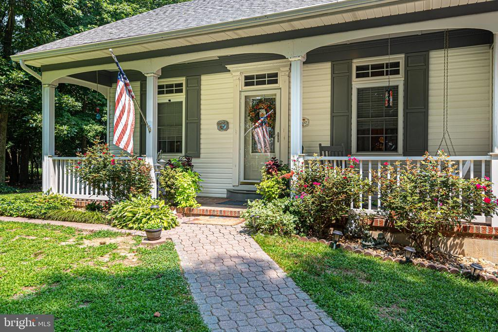 If you are looking for a custom built home with plenty of room inside and out, this is one you have to check out.  The home sits on over 3.5 acres of land that affords you many possibilities.  Private, serene setting and less than 10 minutes from Ocean City!  The inside of the house has 3BR, 2.5 BA (one being a full master suite with walkthrough closet), radiant heat floors, 2 mini-split systems, eat-in kitchen, garage and so much more.  On the property and included in the sale is another building that could be used for storage on the first floor and a 1BR, 1BA full apt on the 2nd floor.  This apt is not completely finished but could be discussed.  You have to see this one in person to appreciate all the details and thought that went into this home.