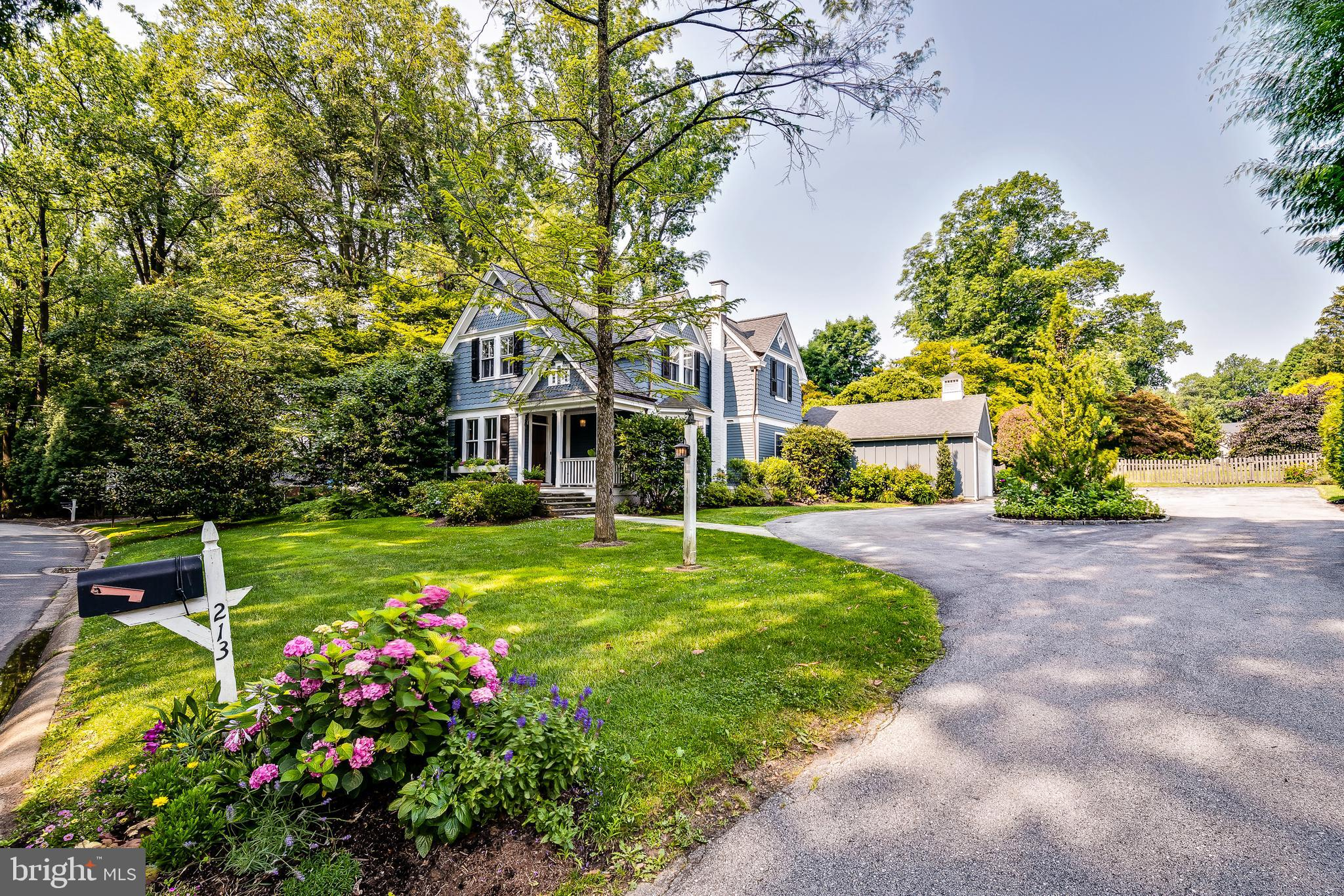"""This stunning Carriage house is the home that everyone has been waiting for. Just over 100 years young, this treasured residence has old world character and has been thoughtfully updated with modern luxuries and amenities that today's seasoned buyer is demanding. Originally part of the Berwind Estate, and sitting on one of the most desirable, manicured, ONE ACRE lots, in the coveted Northwoods section of Radnor Township. Enter this well loved home from the circular driveway, surrounded with specimen trees and perennials, and through the picturesque front porch. Entering the center Foyer you are greeted by boundless light and the grand and elegantly understated staircase. The dramatic formal Living room is ahead and the vaulted ceiling is an architectural marvel to behold in this room. Enormous windows, sliding glass doors, custom built-ins are all anchored by the strategically aligned gas fireplace that is the heart of this room. A discreetly placed Powder bath is off and out of sight. Back through the Foyer is the open and airy Dining room that seamlessly connects to the true heart of this home, the Custom Plato Kitchen. Showcasing every luxury a chef could want including a Sub zero fridge, 4 burner professional Thermador range, professional exhaust, a custom built Grothouse walnut island top and natural stone countertops. The kitchen flows into the completely open concept Family room, with another gas fireplace, walls of windows and sliding doors, another Powder bath and first floor Laundry.  An exquisite """"FLEX"""" room is utilized as a Playroom, but can easily be a Breakfast room or anything else your imagination can dream of in this truly creative space. Access the Flagstone patio with a pergola that is an entertainer's dream, with stunning views of the securely fenced, expansive lawn. The second floor unfolds 3 spacious bedrooms all with generous closet space, a classically appointed hall Bath room and the show stopping Principal bedroom suite. Yes another room, t"""