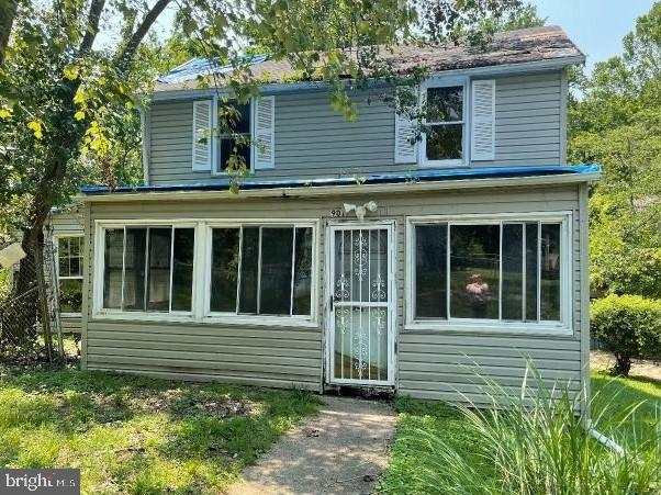 Rehab Ready!  This 2 level farm house style home is ready for your full renovation ideas. Located on a deep corner lot with detached garage awaits an amazing opportunity to fully restore a great beauty.  Sold as-is.  All offers require proof of cash funds to close.