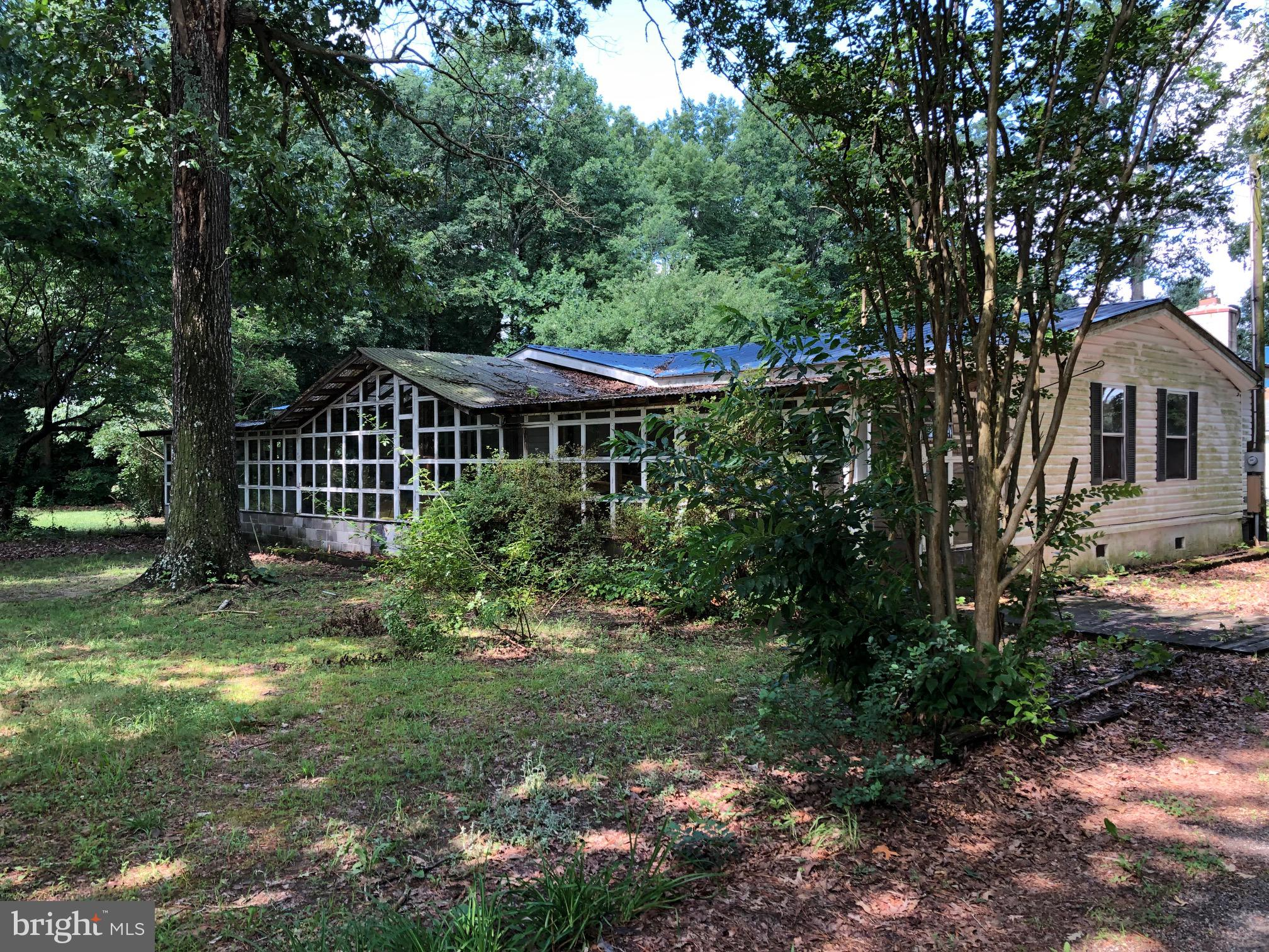 This 3 bedroom 2 bath home is on over an acre of land on the outskirts of Ellendale. This home has lots of potential! With some TLC this will make a quaint home or a great rental property. It's on a very quiet street.  Owner is waiting on the Class C certification and a septic inspection. Home is being sold as is.