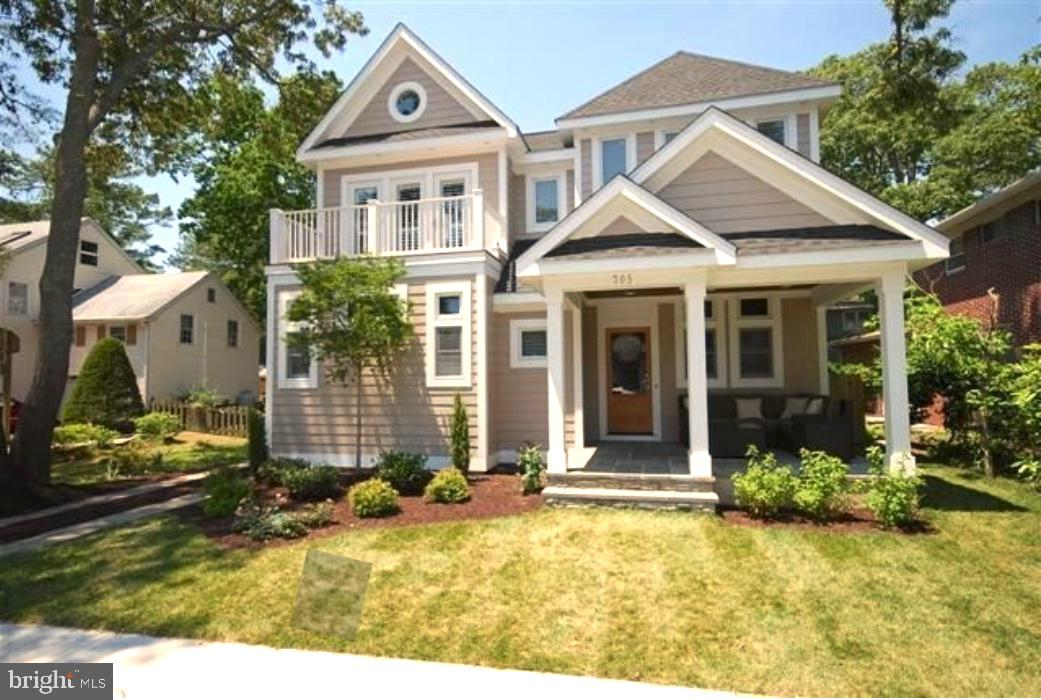 """Situated on the coveted SOUTH REHOBOTH, this elegant custom built 5 BEDROOM, 5.5 BATH, 3,000 SQUARE FOOT home of sophistication & distinction with IN-GROUND HEATED POOL and HOT TUB, also known as """"King Charles Manor,"""" is located a block from Rehoboth's renown boardwalk and beaches and a short walk to downtown dining, shopping, and entertainment.  The home features sizable first and second floor owner suites with gas fireplaces, conditioned crawl space, and an elevator for the ultimate convenience.  This home was designed with coastal living and entertaining in mind with an open floor plan which features a spacious living area, dining area, and exquisite gourmet kitchen complete with granite counters, ample storage and custom cabinetry, dual ovens, gas range, dishwashers, refrigerator, wine refrigerator, extra refrigerator, and much more and all overlooking a beautiful in-ground pool with waterfall cascading form the hot tub.  There is also a well-sized dining area off the kitchen.  There are custom closets in every bedroom, custom tiled bathrooms, 10 foot ceilings on the first floor and vaulted ceilings throughout the 2nd floor.  Hardwood floors flow throughout the home, blending beautifully with the elegantly appointed finishes & custom trim detail including coffered ceiling.  The home also has a custom professional state-of-the-art sound system throughout with multi-zones.  The yard is complete with privacy fencing, landscaping, a heated gunite in-ground pool, outdoor shower, outdoor dining area, and a direct feed gas grill.  Not only has this home been impeccably maintained and tastefully decorated, it offers an impressive rental history.  This home was built prior to zoning changes and the size of this home cannot be duplicated!"""
