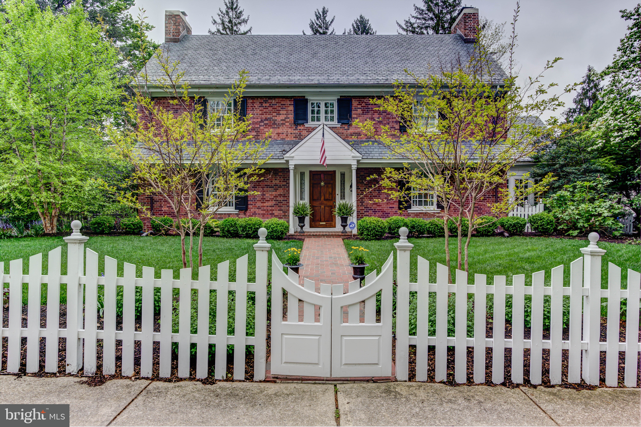 Architecturally and historically significant City home in superior condition. Over the past 20 years owners have lovingly restored and improved upon all original spaces of home. Home has been featured in Delaware Today magazine and Heart of the Home Kitchen Tour. Its outstanding gardens have been awarded several different Garden Club awards. Features of the home include designer kitchen with custom cabinetry, commercial appliances including Wolf cooktop, Subzero refrigerator and wine cooler, and Dacor warming drawer, granite countertops, and island with walnut countertop. The upper level includes a master suite with 4 piece newly renovated bath, 3 other generous bedrooms, 2 full baths, and a second floor den that could easily accommodate overflow company as a 5th bedroom.  The main floor boasts a family room off of kitchen with barrel-vaulted ceiling, Dining room with custom molding details, a Living room with fireplace, powder room, and a bright, glass-surrounded Sunroom overlooking private brick terrace. An attached 3-car garage offers convenience and ample parking. The lower level with outside entrance includes a media room with fireplace, powder room, workshop area, and laundry room. The rear yard offers absolute privacy, award-winning perennial gardens, and a Koi pond. Outdoor enjoyment is enhanced by two custom built arbors, one with seating. Front yard is enclosed by a hand-built custom fence. The house is systematically updated throughout including 2-zone A/C, natural gas heating and hot water, slate roof, Sentricon colony elimination system, and French drain/sump pump system. Just minutes from the restaurants and shopping of Trolley Square and downtown Wilmington.