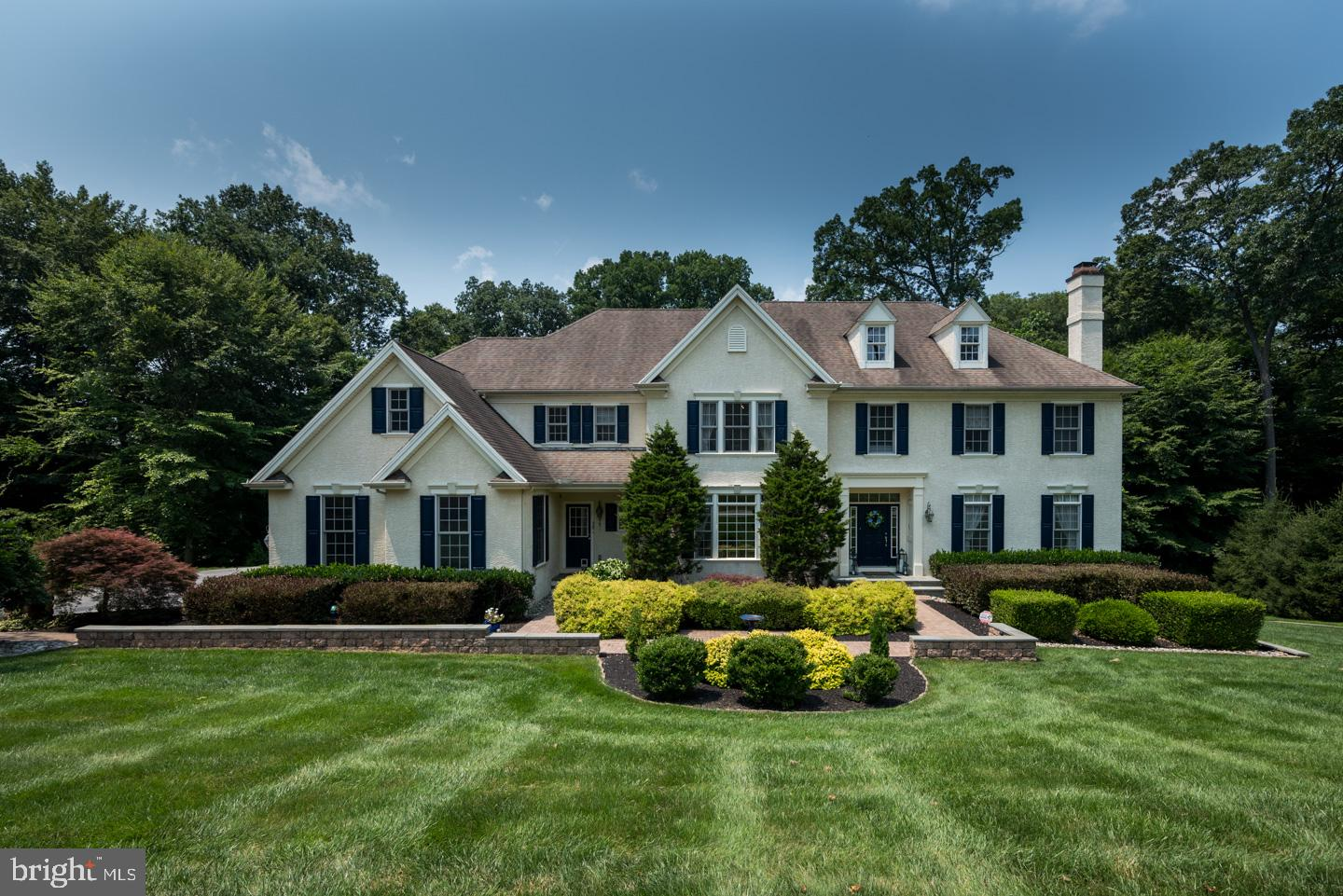 Welcome to 915 Shenandoah Lane, in the highly regarded community of Shenandoah.  Perched amidst 1 acre of land with a backdrop of the lush Chester County landscape, this elegant home offers over 5,800 square feet of bright and well-appointed living space.  Featuring an open floorplan, gourmet kitchen and butler's pantry, breakfast room, first-floor library/office, dual staircases, 5 fireplaces, finished walk-out lower level with full bath, two outdoor entertaining spaces, 3-car garage, security system, sprinkler system, and high-end details you will appreciate.  A meticulously manicured landscape and custom hardscape with stone detailing and walkways welcome you to this stately home.  Step inside to an expansive foyer with an inspiring, two-story window view of the greenery that surrounds this home.  On either side of the foyer, gracefully arched entryways lead to the formal Dining Room and Living Room with wood-burning fireplace, both with lovely crown and chair moldings. Flow into the open floorplan joining the expansive kitchen, great room, and breakfast room; the ideal space to savor your everyday routine.  This kitchen features 42-inch cabinets with undermount lighting, granite countertops, 2-tier large center island with seating, stainless steel appliances, and perfectly equipped butler's pantry just around the corner with wine refrigerator. Opening to the kitchen is the bright & spacious great room with vaulted ceiling, floor-to-ceiling stone fireplace, and windows on three sides providing beautiful natural light.  Off the kitchen is the bright & airy breakfast room which extends outside to the private custom deck, where you won't see a soul. With tree-top and sunset views through the trees, gas fireplace, and curved counter & seating area, you may just spend all of your time here relaxing, dining, entertaining, or just enjoying the fruits of your labor. Finishing out the first level is a beautiful library/office with built-in shelving, a powder room, a large