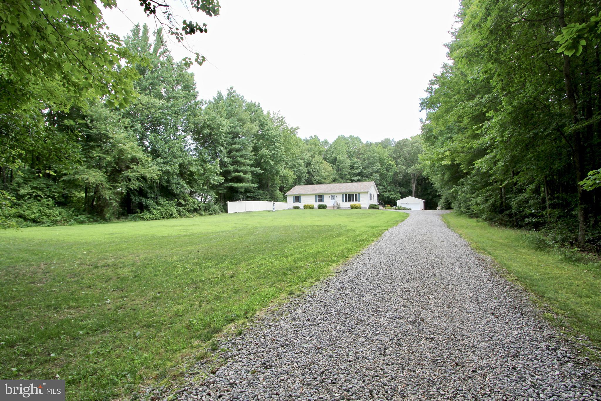 All offers are due to the listing agent by Friday at 7PM WOW!!! Great ranch home is ready for a new owner. Setting on 3 acres and partly wooded.  This home has been undated and nothing to do but move in!! The country kitchen has a breakfast bar, a large eating area and just outside is a beautiful deck with a sun setter awning.  There is a spacious living room and three nice size bedrooms. One bedroom has a Murphy bed for guest or  tuck it away for a roomy office. The 3rd bedroom is used as a man cave. A cheerful main bedroom has it's own bath with a large shower or step out the doorway to a private hot tub. The back yard sports an awesome screened gazebo for entertaining! There is a detached 2 car garage just before you enter the wooded area. Ride the trails and enjoy the rabbits, squirrels, birds and often a deer. This is a wonderland delight !!!!