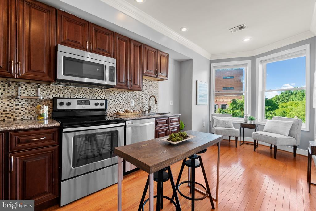 PRICE REDUCTION! **LOW FEES AND INVESTOR FRIENDLY** You will love this location! Beautiful 1BR/1BA in popular Shaw/LeDroit Park! You'll love the natural light throughout, tall ceilings, and hardwood floors. The living room has great light and an area for dining. The living room adjoins to an updated kitchen featuring  stainless steel appliances, granite counters, and ample cabinet space. Relax in the large bedroom and unwind in your your stylish and bright bathroom! On top of that, you have a W/D and extra closet/storage space in the unit too! Pet friendly with a low, low condo fee. This Shaw location can't be beat - walk to some of the city's most dynamic restaurants and nightlife! Shaw's Tavern, Royal, Howard Theater, Atlantic Plumbing - all within a few steps. Metro and grocery just a few blocks away! Hurry, this one won't last long!