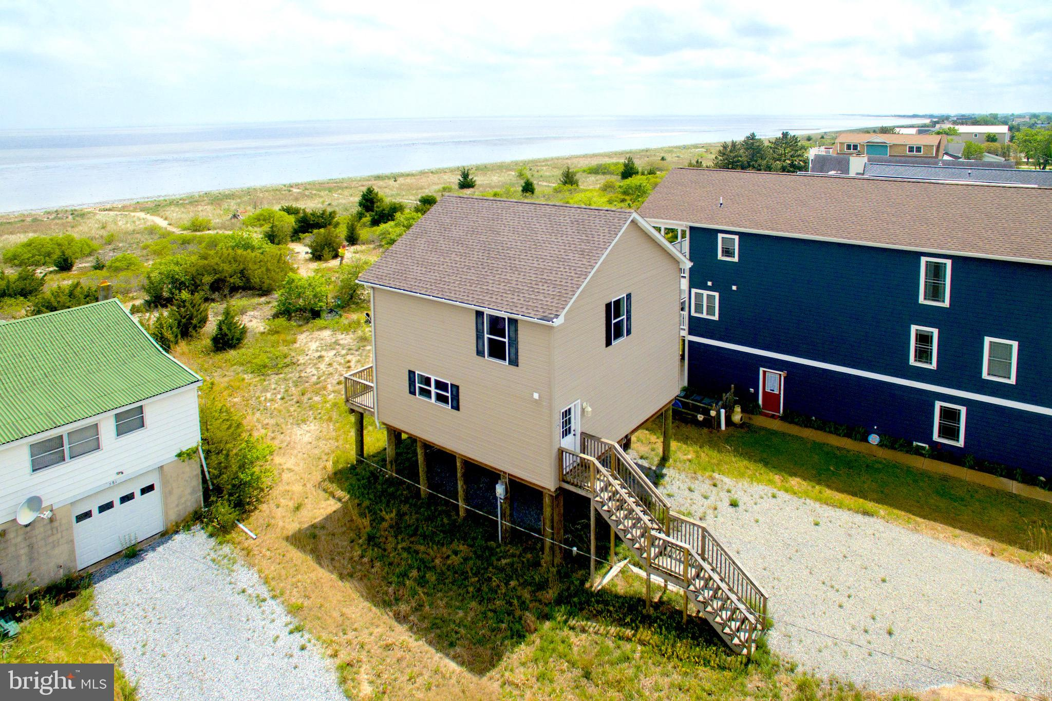 Bayfront/waterfront - New construction/ never occupied -  Enjoy Panoramic Bay views and brilliant sunsets from this new Waterfront home on Slaughter Beach .  Constructed in 2016 but never occupied this home is good as new.  A modern floor plan with a bright kitchen and main living area facing the Bay, this home is move-in ready and begging for the finishing touches of it's new owner.  The second floor features a bay front master suite, 2 additional bedrooms and a full bath.  Welcome Home!!