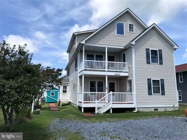 Large Beach inspired coastal contemporary home offers 7bnedrooms, 5 full baths and 6 decks.  Only minutes to Bethany Beach and just a short ride to many other iconic beach towns, easy bike or walk through the convenient trails of Fresh Pond State Park or Assawoman Canal Trail to Bethany. Surrounded by water, this location affords you fantastic panoramic water-views from every window, slider or door, and feels like you're in a Venetian paradise as boats, kayaks and paddle boards slowly navigate the tranquil scenery. Sixty-feet of private well-kept bulkhead provides personal boat docking, large enough for a boat, a pair of jet skis, and kayak/paddle board launch. Perfect for the water sportsman, there is easy access to the deep waters of Indian River and Ocean Inlet for some serious off-shore fishing excursions. Crab or fish from your bulkhead or any number of hot spots your boat can take you for a relaxing day out on the water.
