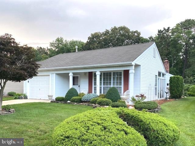 PRICE REDUCED!! MOTIVATED SELLERS! Open House Sunday 07/25 1-3 pm!  Beautifully Maintained 2 Bedroom, 2 Bathroom home in the desirable 55+ Community of Leisuretowne. This well desired GAS Warwick model sits on a quiet street and has a private wooden back yard. The potential of this yard is endless. Room for a deck/patio or even a garden as irrigation system has been extended 35 ft off the back of the home for easy maintenance.  As you walk up the sidewalk and enter this  home you will be immediately be taken with the manicured landscape trimmed with natural stone. Sit on the front porch and enjoy the mature shrubs and perennials. Entering in, to the right is the Living Room with large windows, a half wall separates the Dining Room and Sunroom with a sliding door allowing the natural sunlight to fill the rooms. To the left is a Laundry Room and door leading to the 1 Car Garage. Within the garage is an attic with pull down steps for all your extra storage. Enjoy cooking in the Eat- In Kitchen with wood cabinets and plenty of counter space. A door leads off the kitchen to a fenced private patio for grilling and relaxing. Kitchen flows to a Family Room with a gas fireplace to stay cozy on winter nights, The Master Suite features large walk in closet. Second Bedroom to be enjoyed by guest, home office or crafts/hobbies.  Home has a Clean Termite Cert., 1 year Home Warranty is included.  HVAC and Heating Service and Maintenance Agreement is in place and can be taken over by the new owners. Don't miss this home and its location!