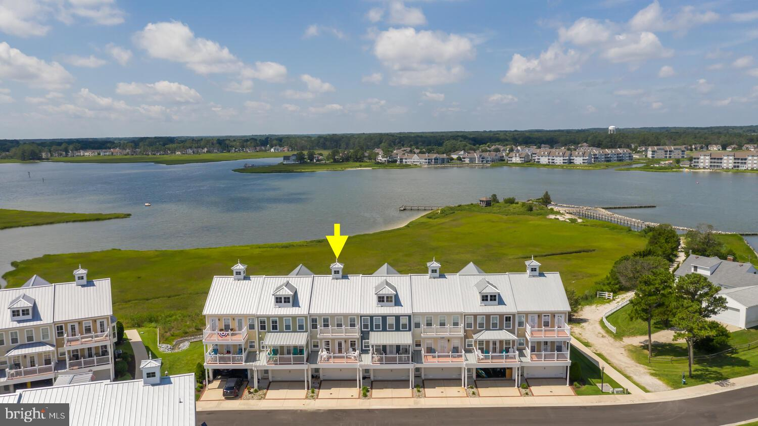 You have to check out these AMAZING views in this sought after WATERFRONT Community of Sandy Cove! Bring your boat to your personal deeded boat slip (#59) with 7000 lb boat lift.  This fully furnished, 4 Bedroom,  3.5 Bath Townhouse features multiple decks overlooking the water, outdoor shower and a 2 car garage to store your toys! Main Living area features hardwood floors, Gourmet Kitchen with double ovens and brand-new cooktop!  Granite counter-tops and additional sitting area off the kitchen leads to a large screened in porch! Upstairs features a Master Bedroom with a huge sitting area overlooking the water plus TWO walk-in Closets!! Sellers are including 2 kayaks for your enjoyment!! Community features Community pool, Marina , private Beach area, Community Fishing/crabbing Pier and Boat Ramp!  All this only a short distance to Bethany Beach, shopping, restaurants and more!