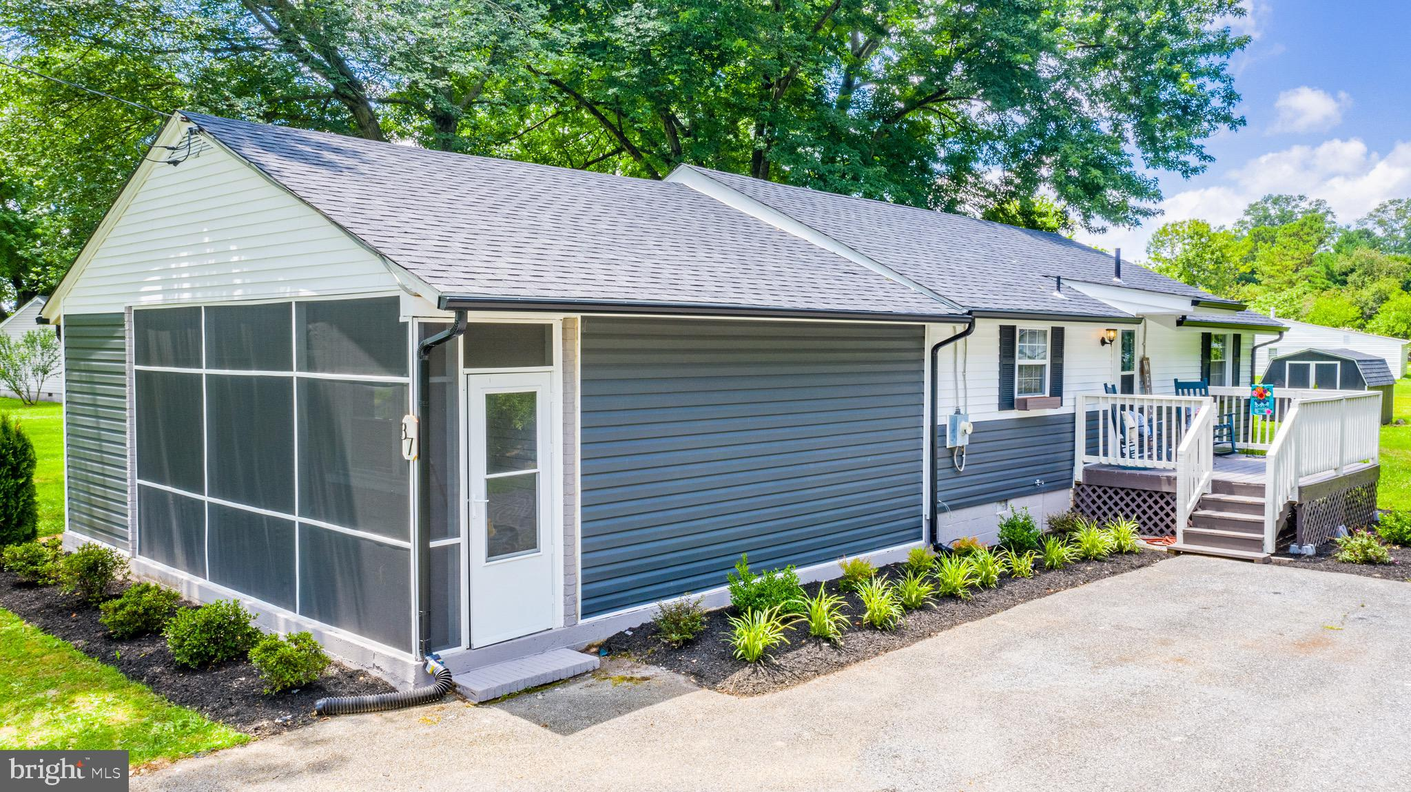 Come see this completely remodeled 3-bedroom, 1.5 half bath Hartly home that is move-in ready! As soon as you pull into the driveway you'll see the newly installed roof (June 2021) and newly installed vinyl siding (June 2021). Beautiful landscaping surrounds this gem. When you open the front door you are  greeted by the bright and airy kitchen that includes a new Whirlpool stainless-steel refrigerator, range with double oven and convection, dishwasher and built-in microwave. An eye-catching backsplash, quartz countertops, recessed lights and an island makes this kitchen to die for! The new central A/C is sure to keep the heat down as it was replaced (June 2021). The entire home has newly installed neutral vinyl planked flooring, except in the spacious family room — which has newly installed carpet and a shiplap accent wall. Other desirable features are a shiplap accent walls in the half bath along with a new toilet and vanity. The washer and dryer is also included and is AS-IS. The renovated full bath has a brand-new vanity and elegant ceramic tile design that even has an alcove for soap and shampoos. The three bedrooms each have new ceiling fans and walk-in closets. This turn key home also an attic for extra storage. You'll find  three ways to enter into this freshly-painted home: front entrance with a deck that leads to the kitchen; back entrance with new Pella sliding glass doors off the dining room to a second deck, and the side entrance has a screened-in porch that is off the high-ceiling family room. All three entrances are the perfect areas to enjoy a tall glass of lemonade as you admire the landscaping and mature trees in this well-maintained yard. The roomy shed also has a new roof (June 2021). Make an appointment to see it today . . . it won't last long!