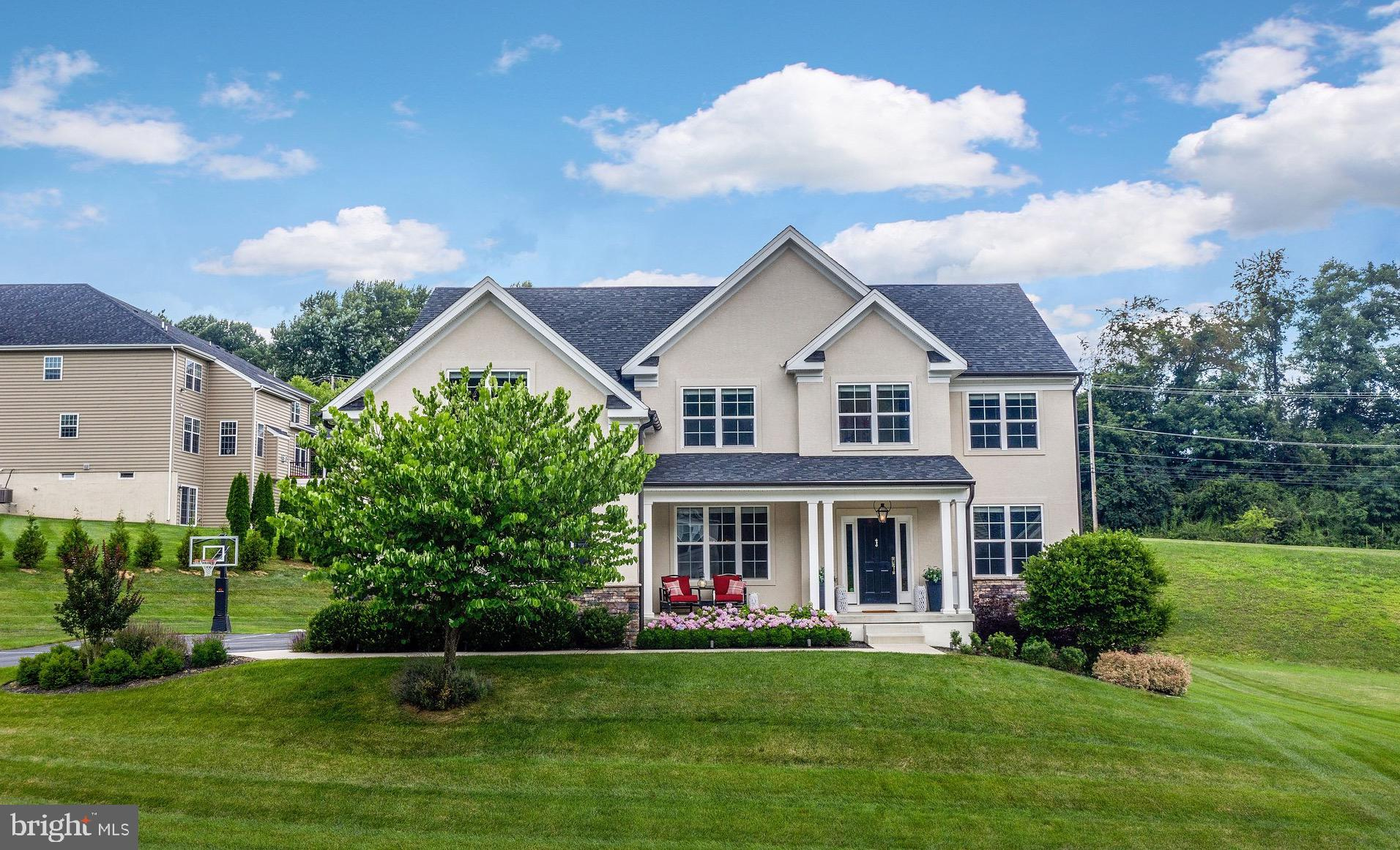 Don't miss this turn-key, extensively upgraded home with more than 5,100 square feet of livable space in popular West Bradford Township! Only 7 years young, 710 Whiffletree Lane offers everything desired by discerning buyers and delivers gorgeous, high-end designer touches, both inside and out. Upon entrance, you'll immediately notice the dark walnut stained hardwood flooring almost throughout the entire main level and into the upstairs hallway, all in mint condition. Off the foyer you'll find formal living and dining rooms, both with extensive wainscoting. Behind the living room is an updated powder room along with a large private office space, perfect for working from home. Walk through the dining room to the lovely coffee and wine bar, complete with cabinetry, a quartz countertop, built-in beverage center and restaurant-quality ice maker. The stunning kitchen features a large center island, gas range, custom range hood, pot filler, double wall oven, upgraded counter depth refrigerator, marble backsplash and walk-in pantry. A light-filled breakfast room offsets the kitchen and walks out onto the large flagstone patio outside. At the heart of the home sits a huge two-story family room with a gas fireplace, extensive windows and a French door leading to the outdoor living room. You will be the envy of the neighborhood with this covered deck, which includes another gas fireplace, a television, integrated speaker system and 4 built-in Lynx heaters making this a space that can be used in all four seasons! The deck connects to a spacious flagstone patio which wraps all the way to the driveway. A laundry room with marble countertops, soaking sink, cabinetry and an oversize two car garage complete the main level. The lovely split staircase leads to a second level as beautiful as the first. You'll notice that the extensive wainscoting continues upstairs throughout the long hallway with hardwood flooring and built-in picture lighting. The owner's suite includes a large prim