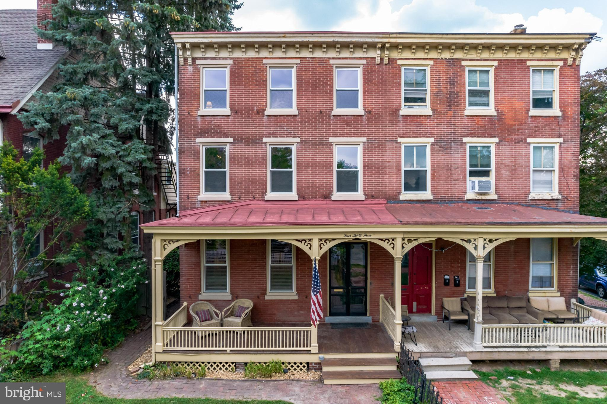 This stunning 1875 3-story brick twin traditional home is located in the heart of West Chester Boro! With over 2,300 square feet of living space, 4 Bedrooms and 2½ Baths, this home blends charming architectural features like hardwood flooring and built-in cabinets and bookcases with modern updates of such as appliances and fixtures. The flow of this home is perfect for living and entertaining! Large windows and high ceilings with exquisite mill work make this home bright and airy. The covered front porch welcomes you into a large foyer.  From the foyer you enter the formal living room which flows naturally into the adjacent dining room.  Off the dining room is access to an enclosed porch, currently being used as an office.  Walking through the dining room you will find the large kitchen which is complete with wood cabinetry, leathered granite countertops, recessed lighting, and stainless-steel appliances. An updated powder room and mudroom room with French doors to private back yard round of this floor. Upstairs, the primary bedroom has an en-suite bath and can also be accessed through the second stairway. 1 additional generously sized bedroom and a full upgraded bath round out the 2nd floor. Along the 3rd floor are two additional bedrooms.  Downstairs the basement is finished and offers lots of extra flex space.  Also in the basement is the laundry room and plenty of space for additional storage.  Out back there is a large detached 2 car garage and off-street parking for one additional car, a rarity in the Boro!   The fully fenced in backyard with a large patio and beautifully landscaped gardens is perfect for entertaining. Short walk to the center of town, restaurants, parks, stores and more.  Schedule your private showing today!