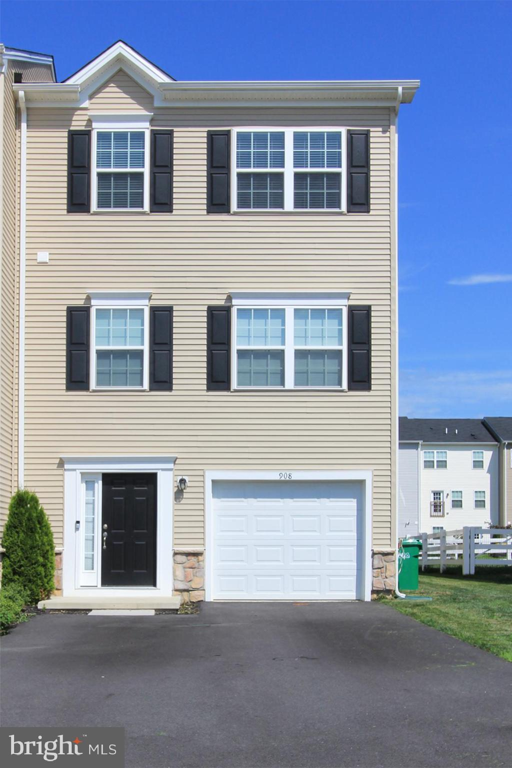 """WHY WAIT FOR NEW CONSTRUCTION WHEN YOU CAN PURCHASE THIS LUXURY TYDINGS MODEL TOWNHOME IN MINT CONDITION! This end unit townhome is just 2 years young and has been meticulously maintained. The 3 story townhome has a fabulous open floor plan with plenty of natural sunlight. Enter the home to a wide foyer that leads to a home office, den, gym, or a 4th bedroom. Also, there is a sliding glass door for easy access to the backyard.  The main level has soaring 9"""" ceilings, hardwood floors, recessed lighting, 42 inch white kitchen cabinets, granite countertops, stainless steel appliances, 7"""" center island that has enough space for 6 counter stools. Enjoy fantastic parties with family and friends. The upper level has a spacious master bedroom with a walk-in closet, en suite bathroom with a large dual vanity and owner's super shower. Additional two ample sized bedrooms and a full hall bathroom completes this level. Conveniently located off of route 1. Your search is finally over. This is a must see! Showings begin Friday 7/17/21."""