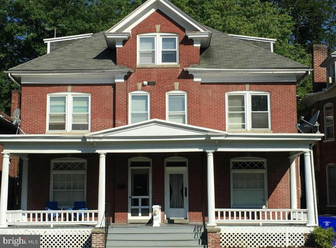 This three story all brick building, is located at the North End of Hagerstown Historic District, in a quiet suburban neighborhood, and features 6 units, five 1BR and One 2BR 1.5 bath units, approximately 750 Sq. ft   each, 3 bay garage in rear off alley. the property offers easy access to transportation, schools, shopping