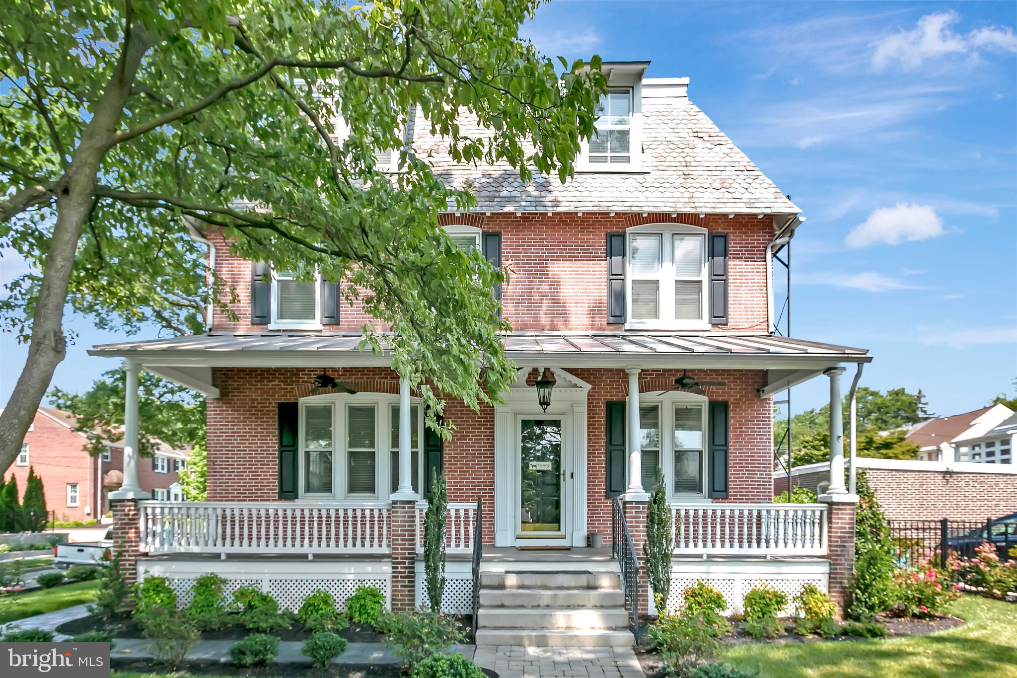 """This graceful Georgian three story brick home on a charming block of North Bancroft Parkway has been attentively cared for by the current owner.  The sweeping ceiling heights and stunning old-growth pine floors are indicative of the era of the home and the quality of construction that is unrivaled by today's standards.  The front foyer, complete with a cozy fireplace, would serve well as a library, sitting room or office space.  The airy great room is generous and allows for plenty of versatility as to its use, with gorgeous built-ins flanking the front triple windows, which flood the room with natural light.  The dining room can accommodate a large gathering and is conveniently just off of the spacious kitchen, fabulously outfitted with the fixtures and amenities that any serious cook would appreciate.  The entire kitchen has been carefully and professionally renovated and reconfigured and features higher-end stainless steel appliances, including a 48"""" Thermador gas range.  The rear enclosed porch completes the first floor and is a great space for casual morning coffee or a relaxing evening at home. On the second level you will find the primary bedroom suite, which includes an en suite laundry room and full bathroom, complete with dual, separate vanities, marble tile, a soaking tub, and an oversized shower.  Two additional spacious bedrooms are on this level.  On the third floor are three more bedrooms and another full bathroom with a plethora of space. The owner has put great care and attention into the hardscaping, retaining walls and landscaping on the grounds of the property, giving this home wonderful curb appeal. With plenty of living space and amenities for the modern buyer, this home is not to be missed."""