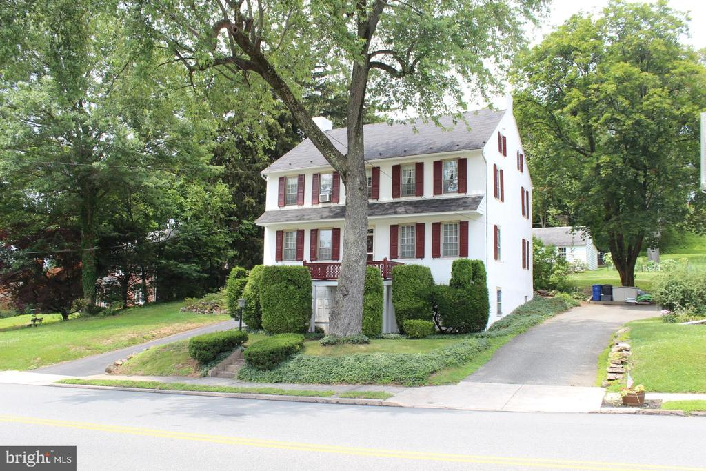 One of a kind rare opportunity to own a historic Boyertown Home dating back to 1,700's. Welcome to this stately, timeless colonial home dating back to 1,700's, situated on .33-acre property. Features include spacious formal living basked in natural light, dining room w/original random plank hardwood floor, chair rail and chandelier w/dining.  Fully remodeled custom eat-in kitchen w/solid wood cabinetry, Corian counters w/undermount double sink, glass top cooking, dishwasher and dining area overlooking rear yard and covered patio.  The traditional wood turned staircase leads to the second-floor landing providing access to master bedroom suite w nicely sized closet overlooking rear yard. Second bedroom w/built in bookcases and double desks. Two additional bedrooms provide addition options for growth and family as well as center hall full bath.  Lower lever office/den w/full walk-in fireplace and pine paneling is ideal for work from home office or study area.  There is second finished room (currently used as storage room) that can provide additional living area w/ many uses.  Original home had Two (2) front entrances on ground level and steps leading to main level of home.  Unfinished basement laundry / utility room, 200-amp electrical service.  Home is meticulously maintained, inside and out and truly a one-of-a-kind home.  Detached two car garage, w/workshop, and beautiful yard.  Centrally located minutes schools, shopping, entertainment, and major arteries.
